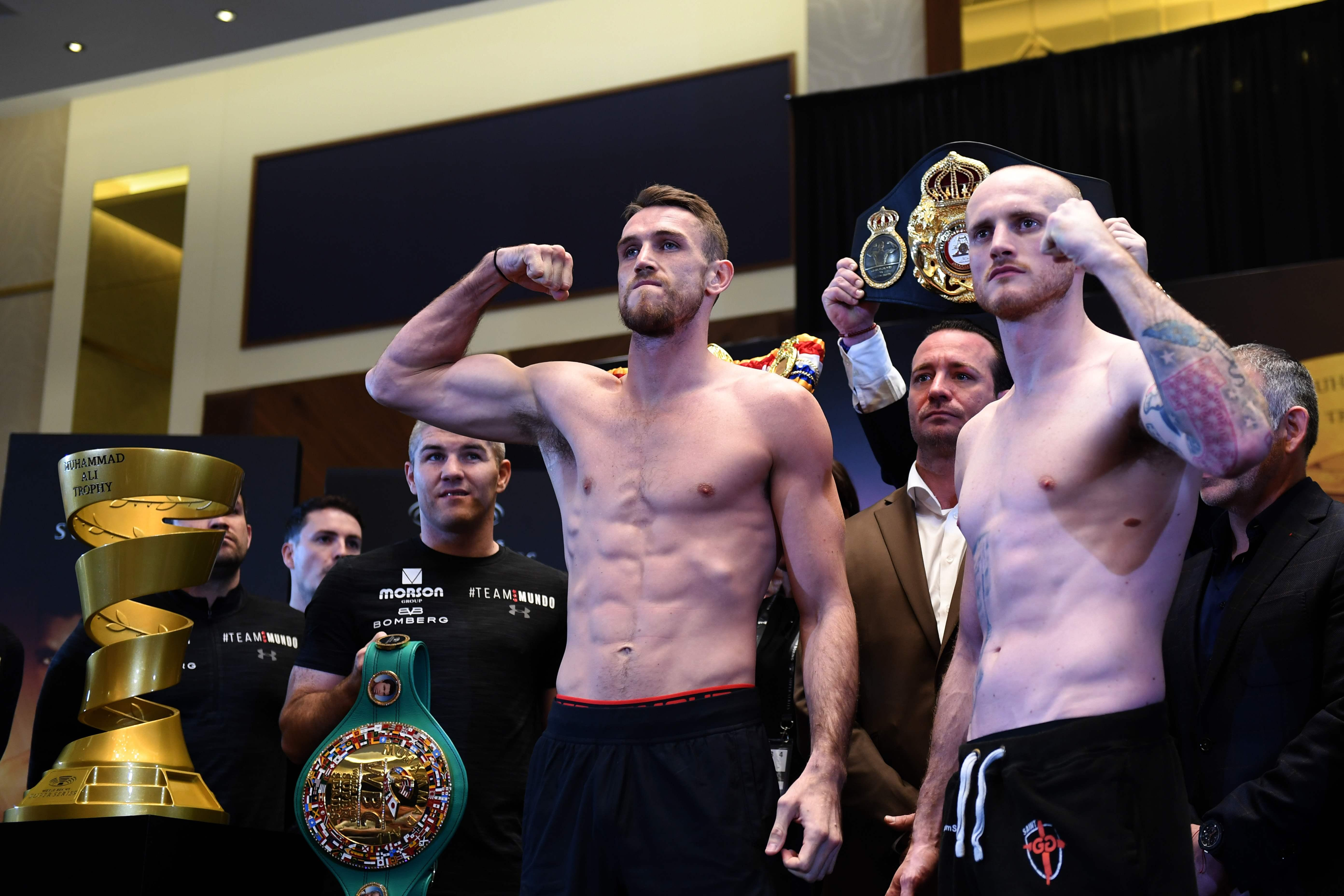 Callum Smith and George Groves pose next to the Muhammad Ali trophy after their weigh in yesterday