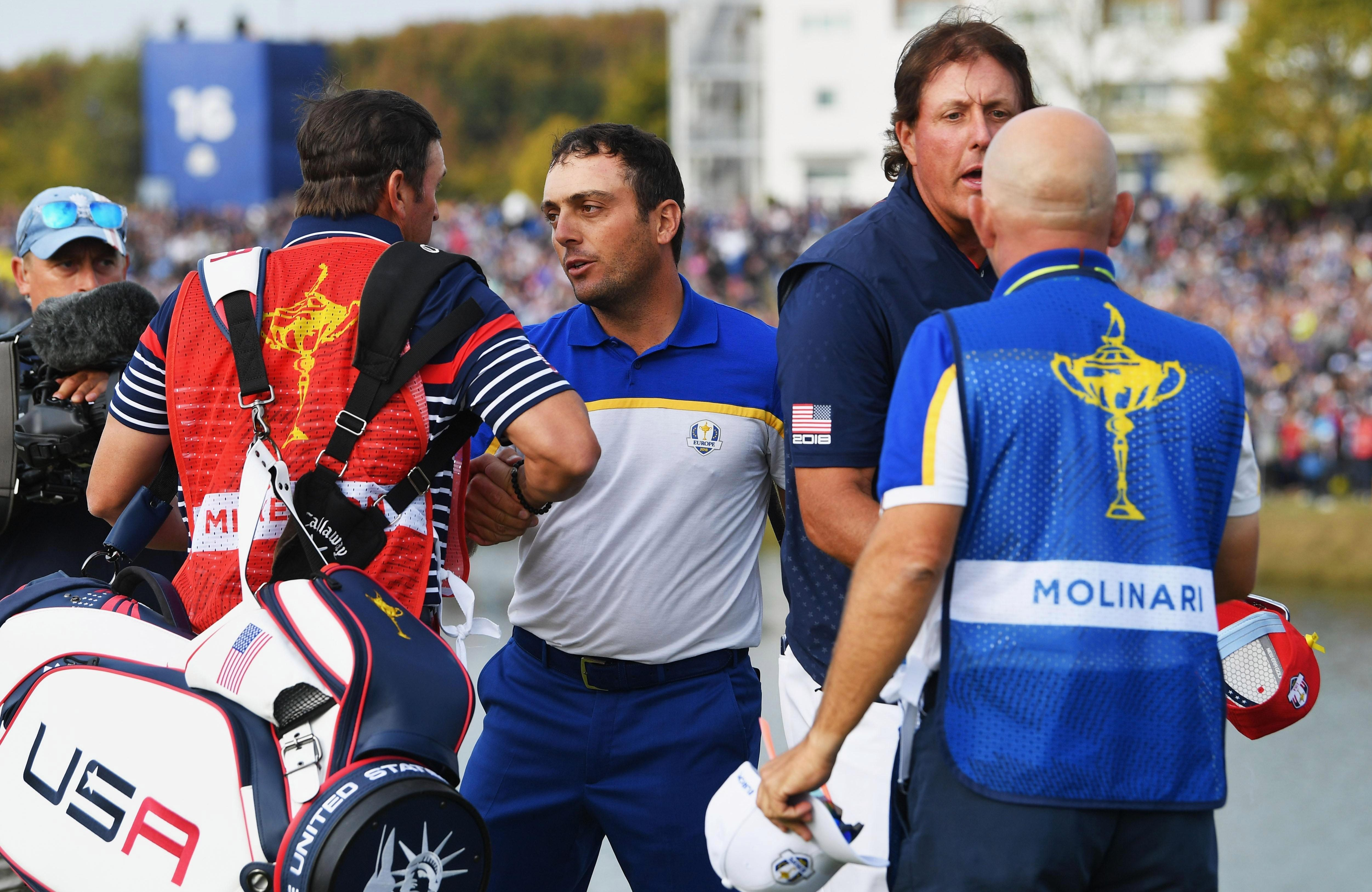 Francesco Molinari and Mickelson shook hands as the American conceded the point to Europe