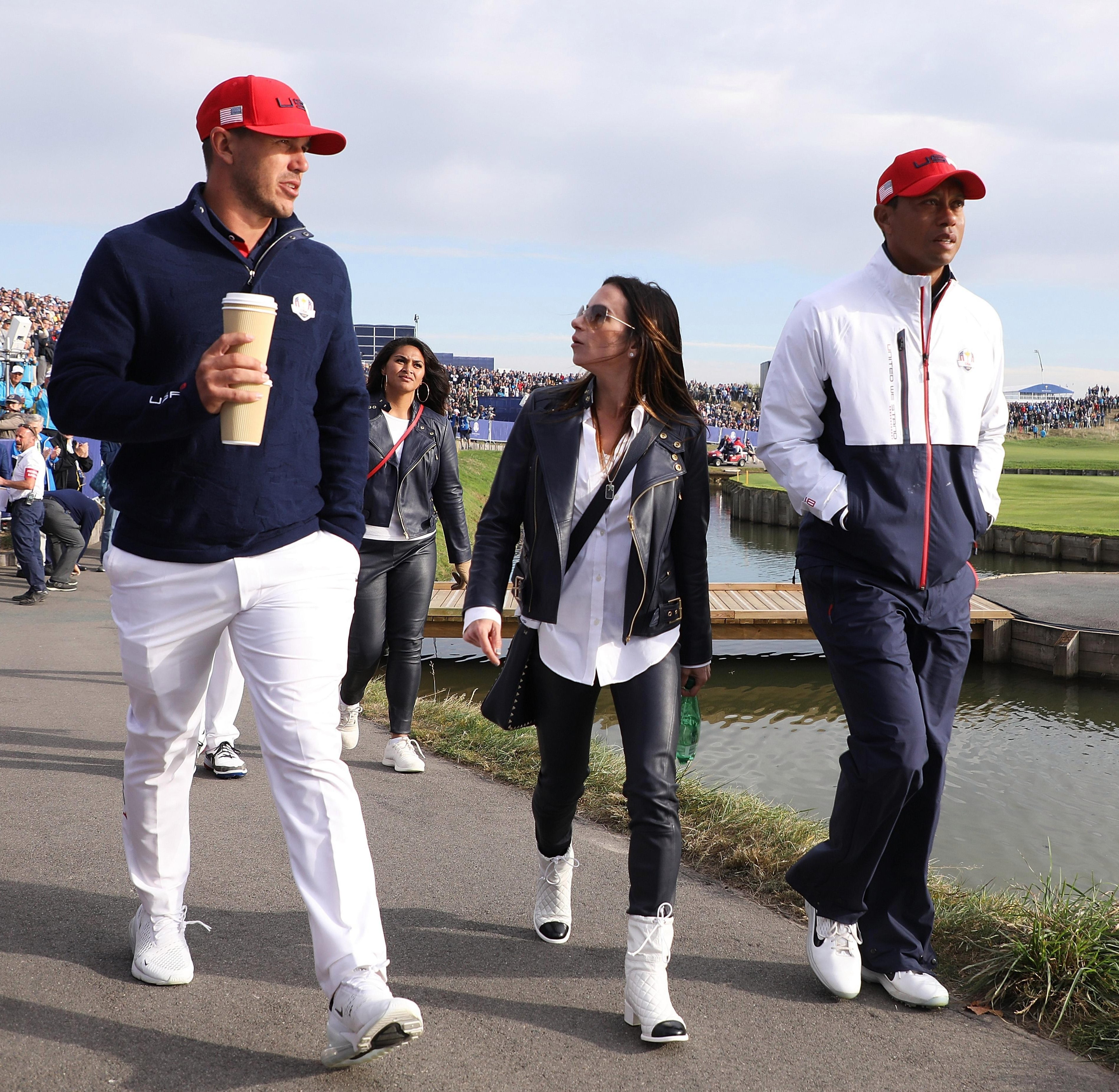 Tiger Woods and girlfriend Erica Herman trudged away from the course after defeat