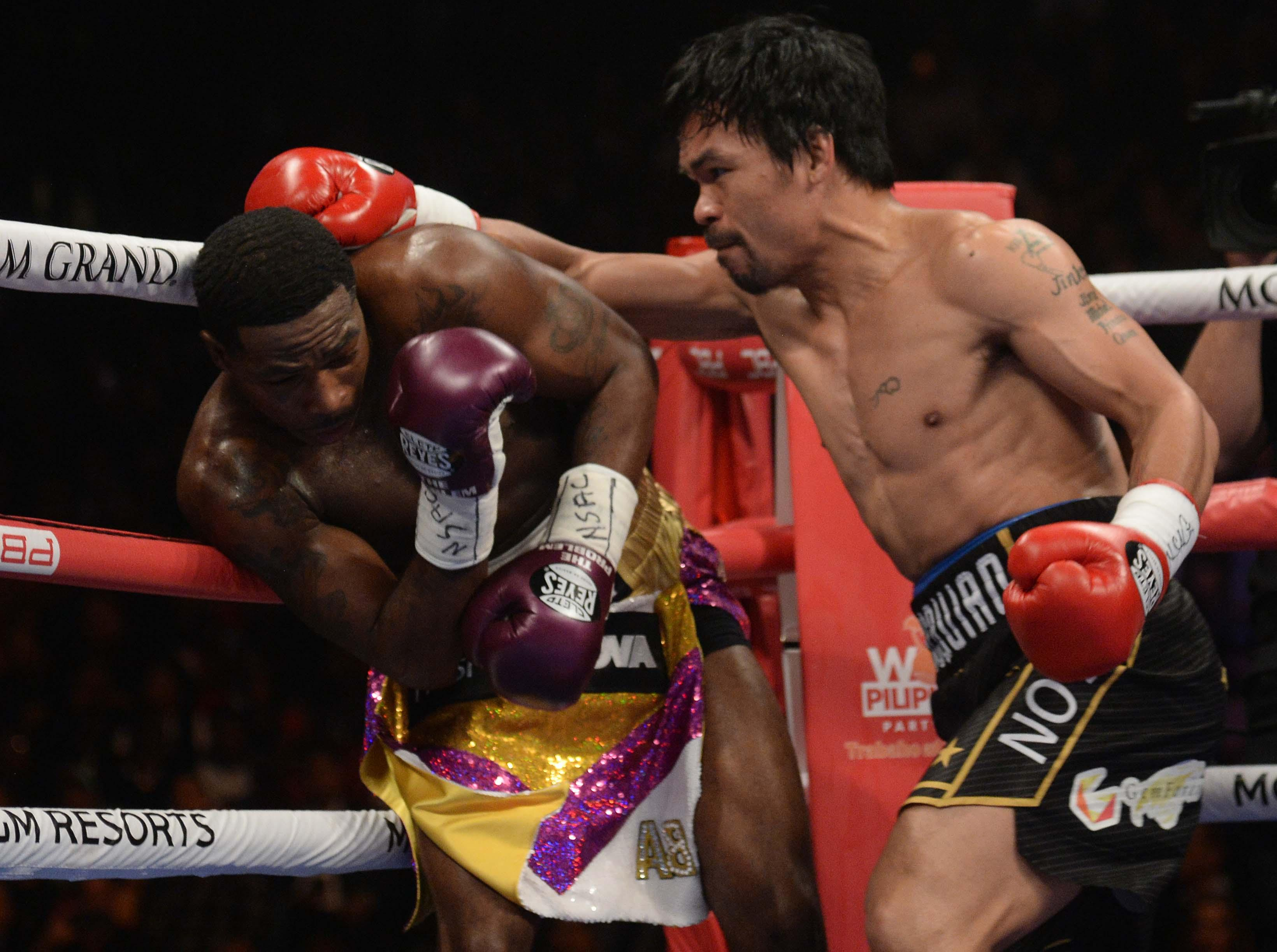 Pacquiao hurt Broner in rounds seven and eight with a left hand