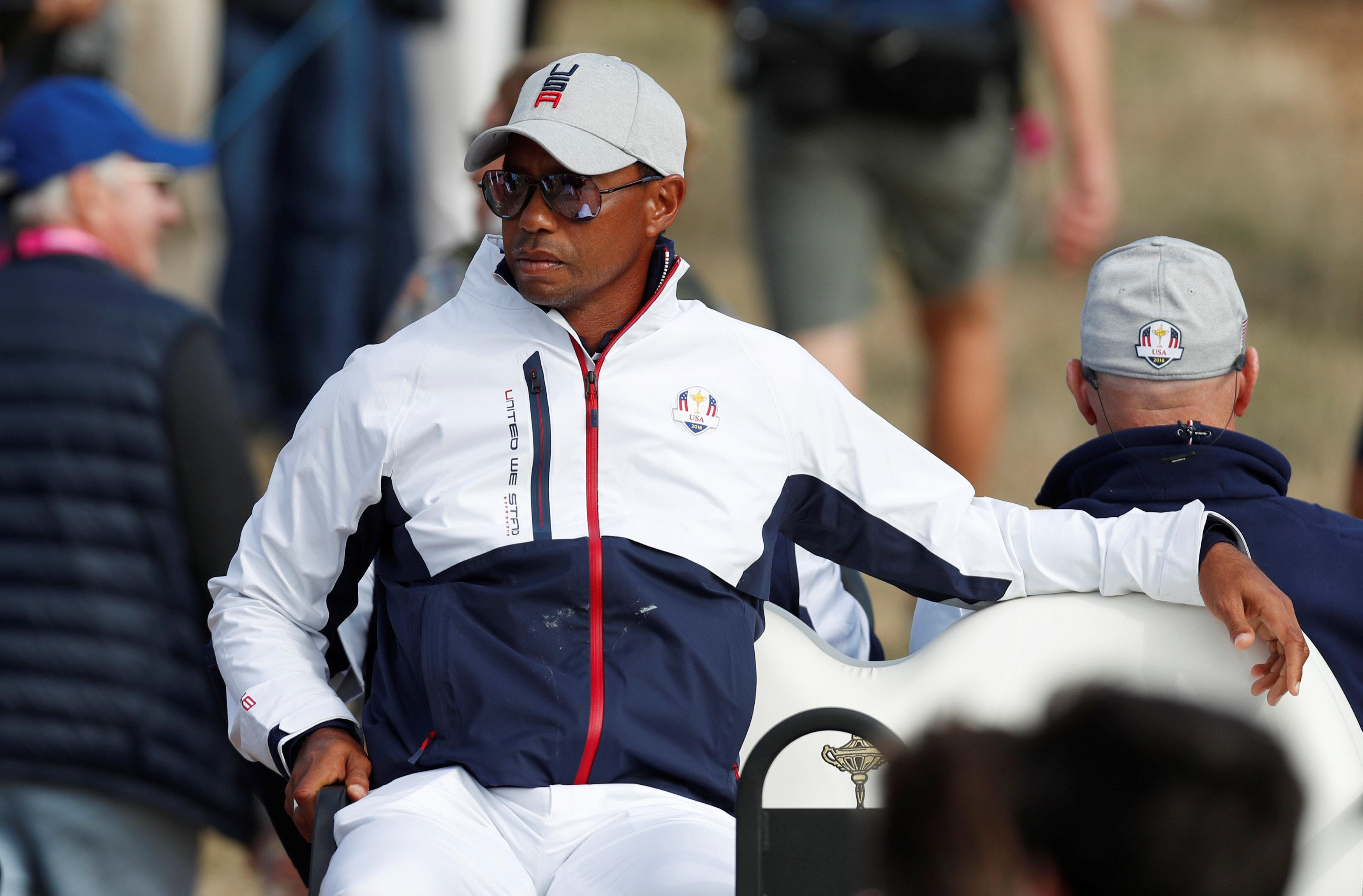 Woods was dropped for the Friday foursomes afternoon session but was on the course supporting team-mates