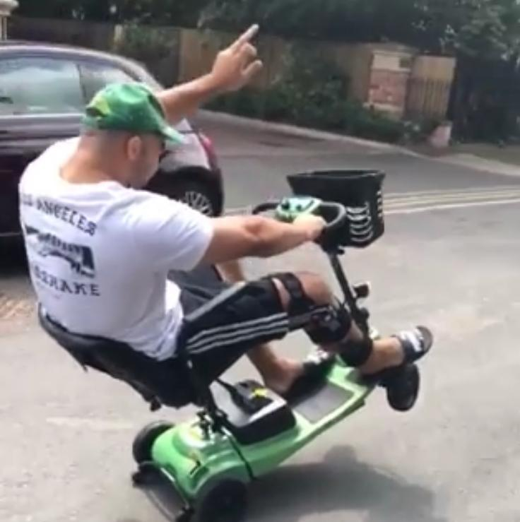 Ellis Genge pulling a wheely in his mobility scooter