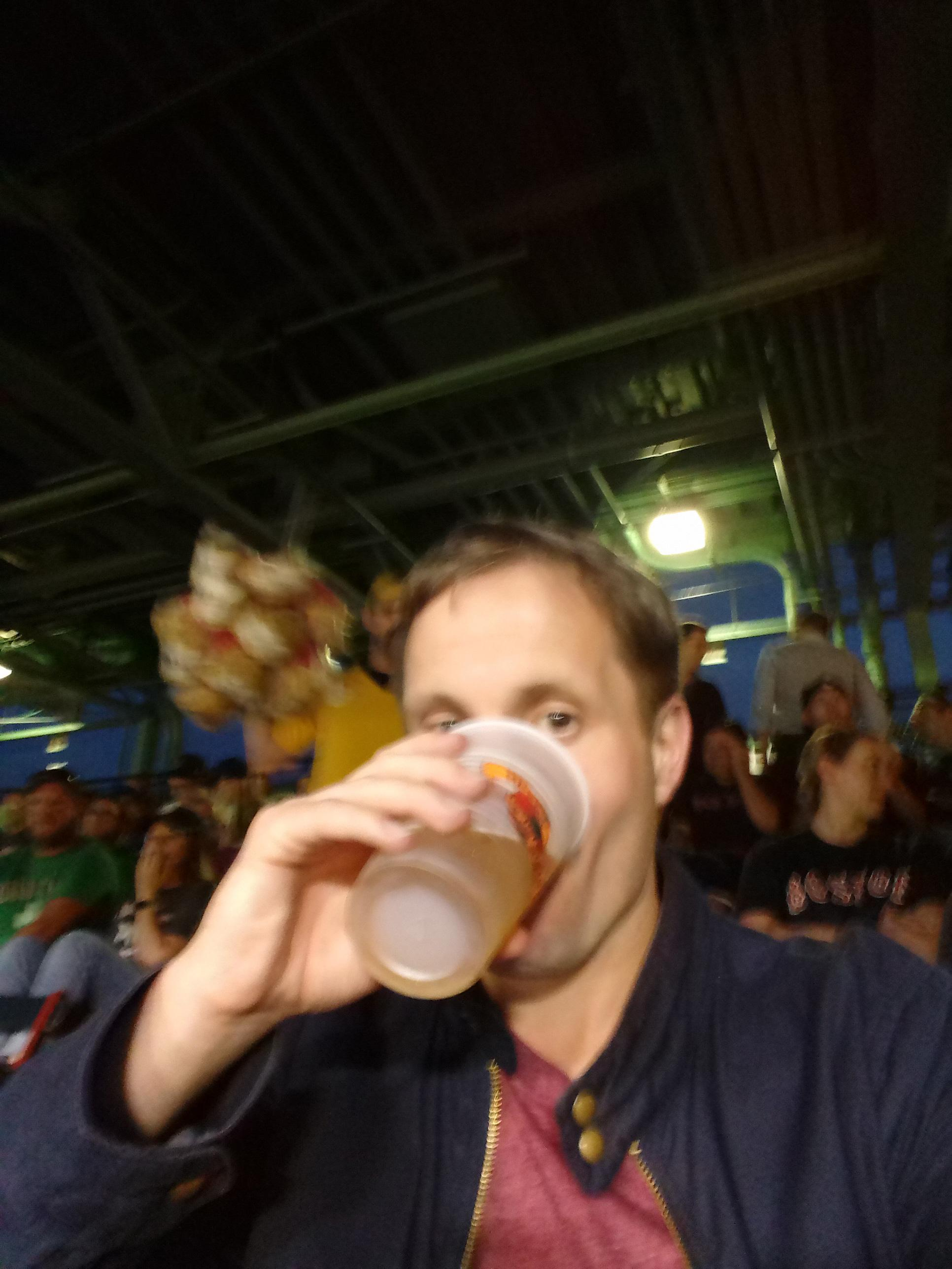 Phil Gradwell enjoys a beer at Fenway Park