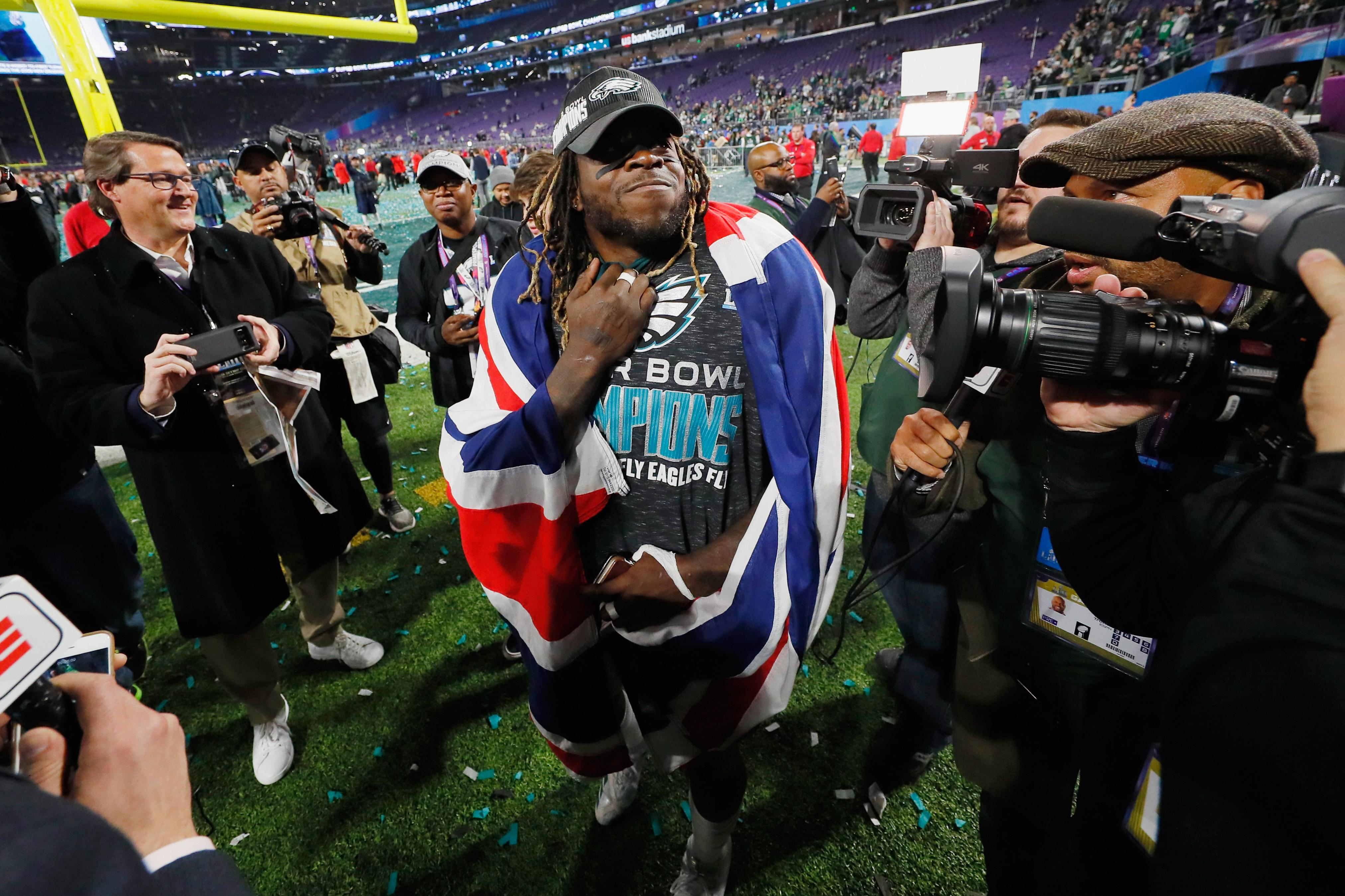 Ajayi celebrates the Philadelphia Eagles' Super Bowl win with a Union Jack over his shoulders