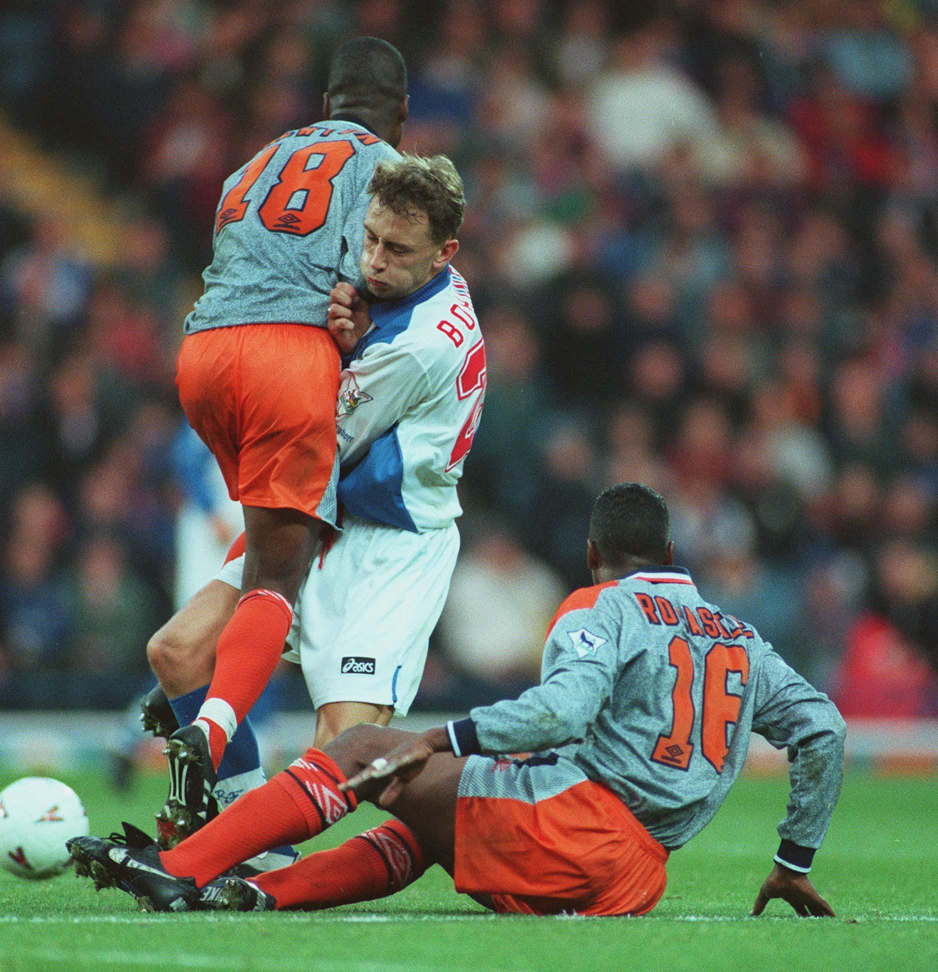 The blues wore and orange and grey away kit from 1994 to 1996