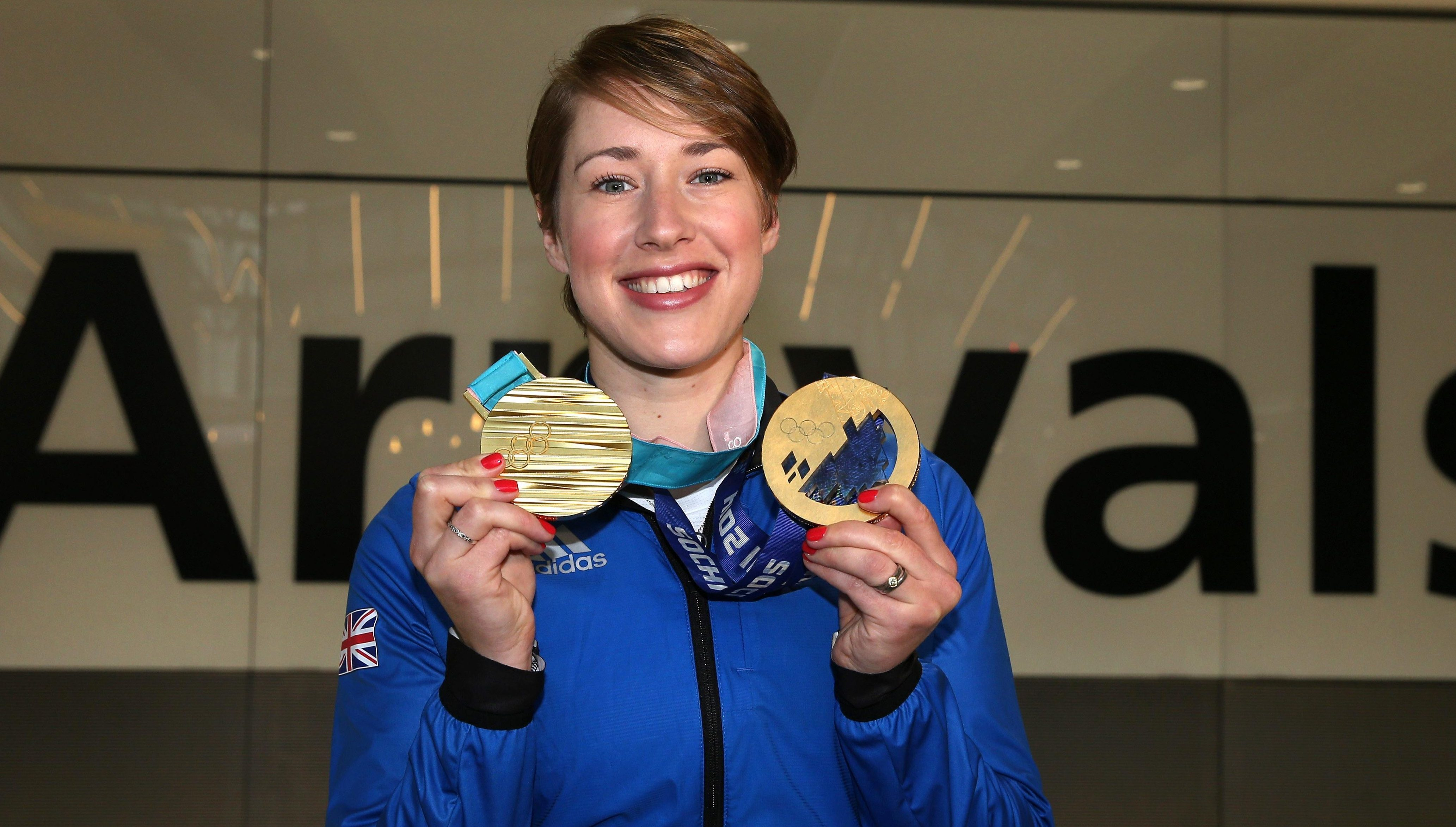 Lizzy Yarnold of Great Britain poses with her Skeleton gold medals