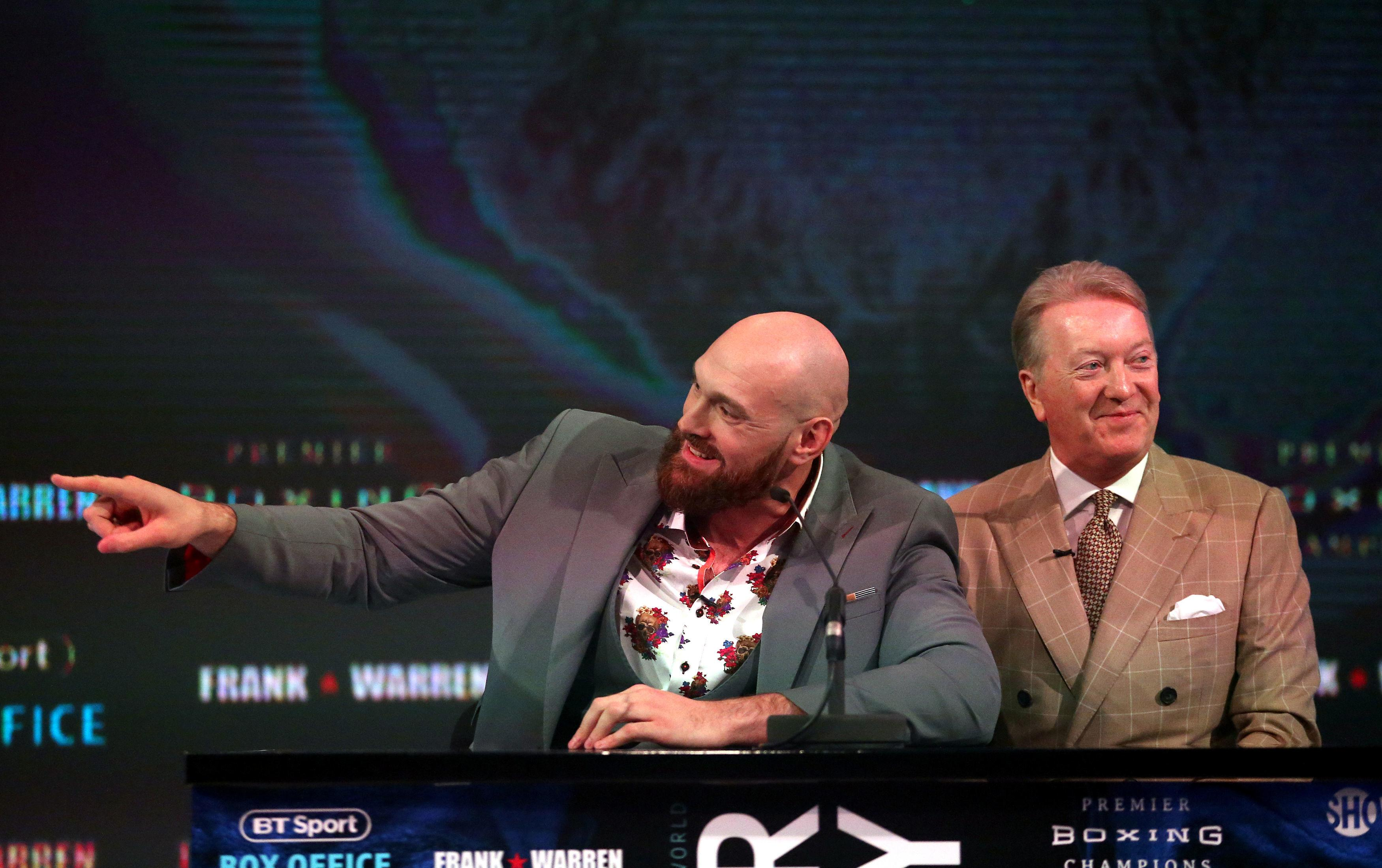 Tyson Fury and promoter Frank Warren during a press conference at BT Sport Studio.
