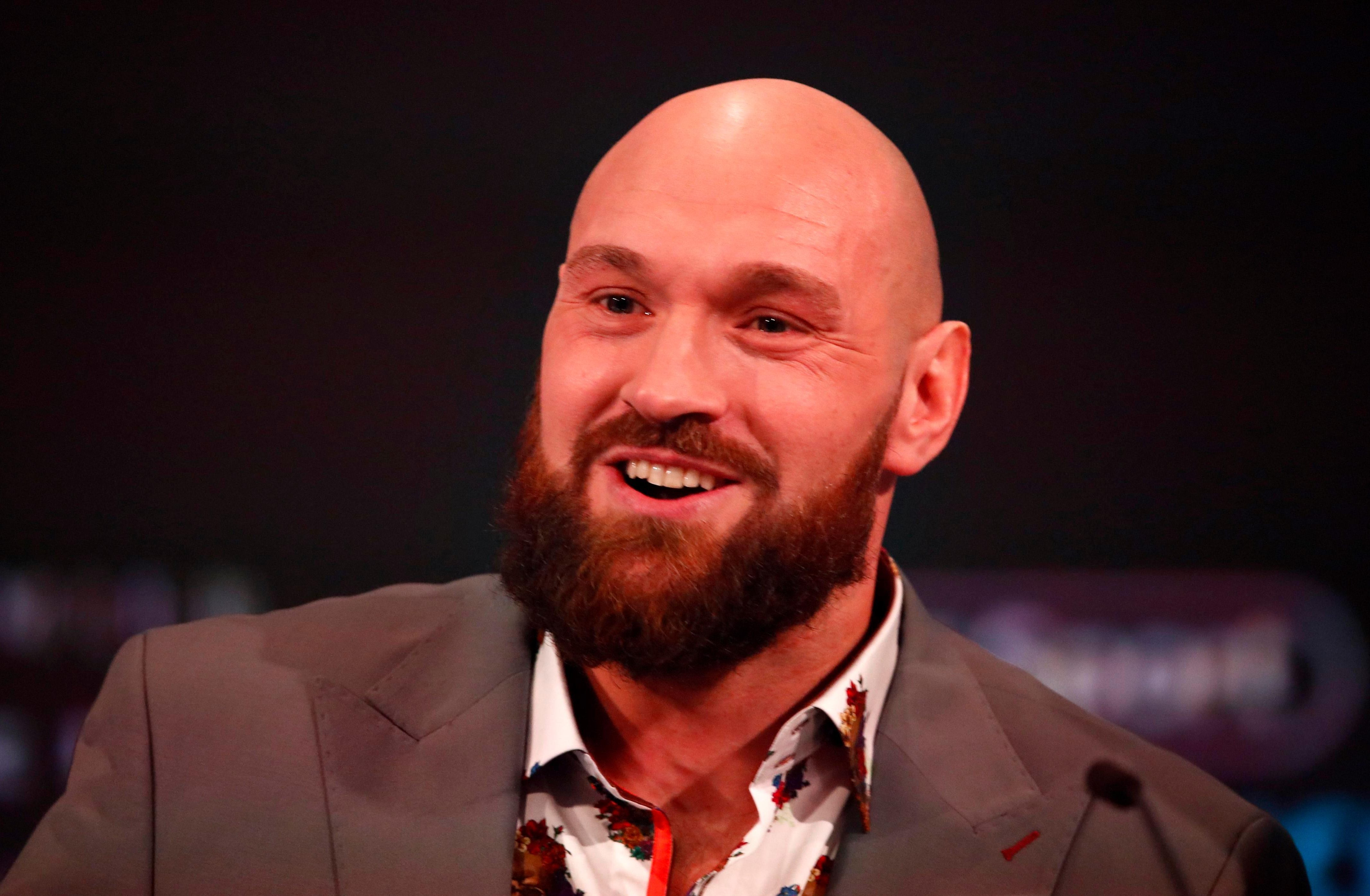 Tyson Fury reacts during a press conference ahead of the match against Deontay Wilde.