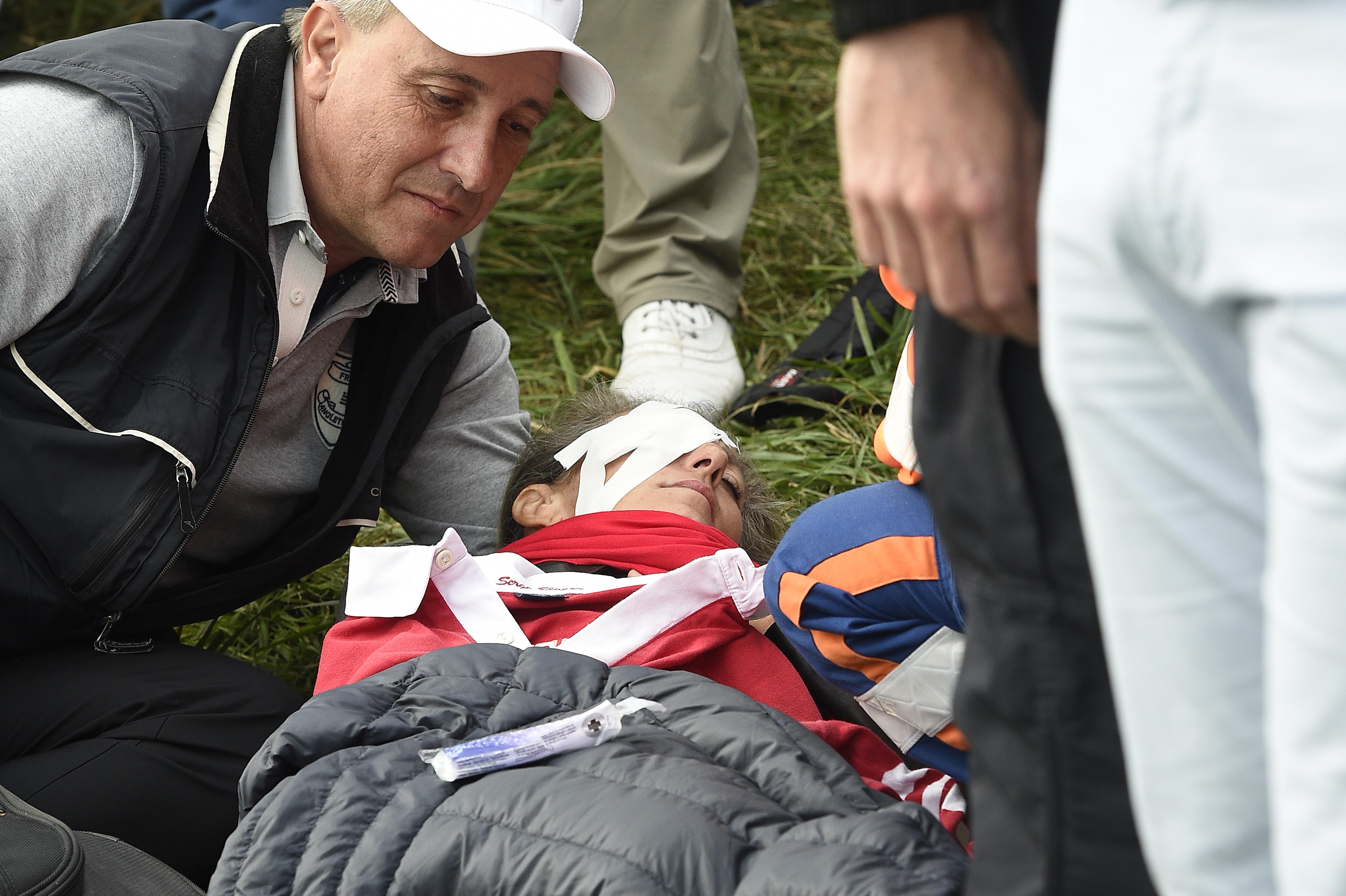 Remande, 49, was struck by a wayward tee shot from American golfer Brooks Koepka