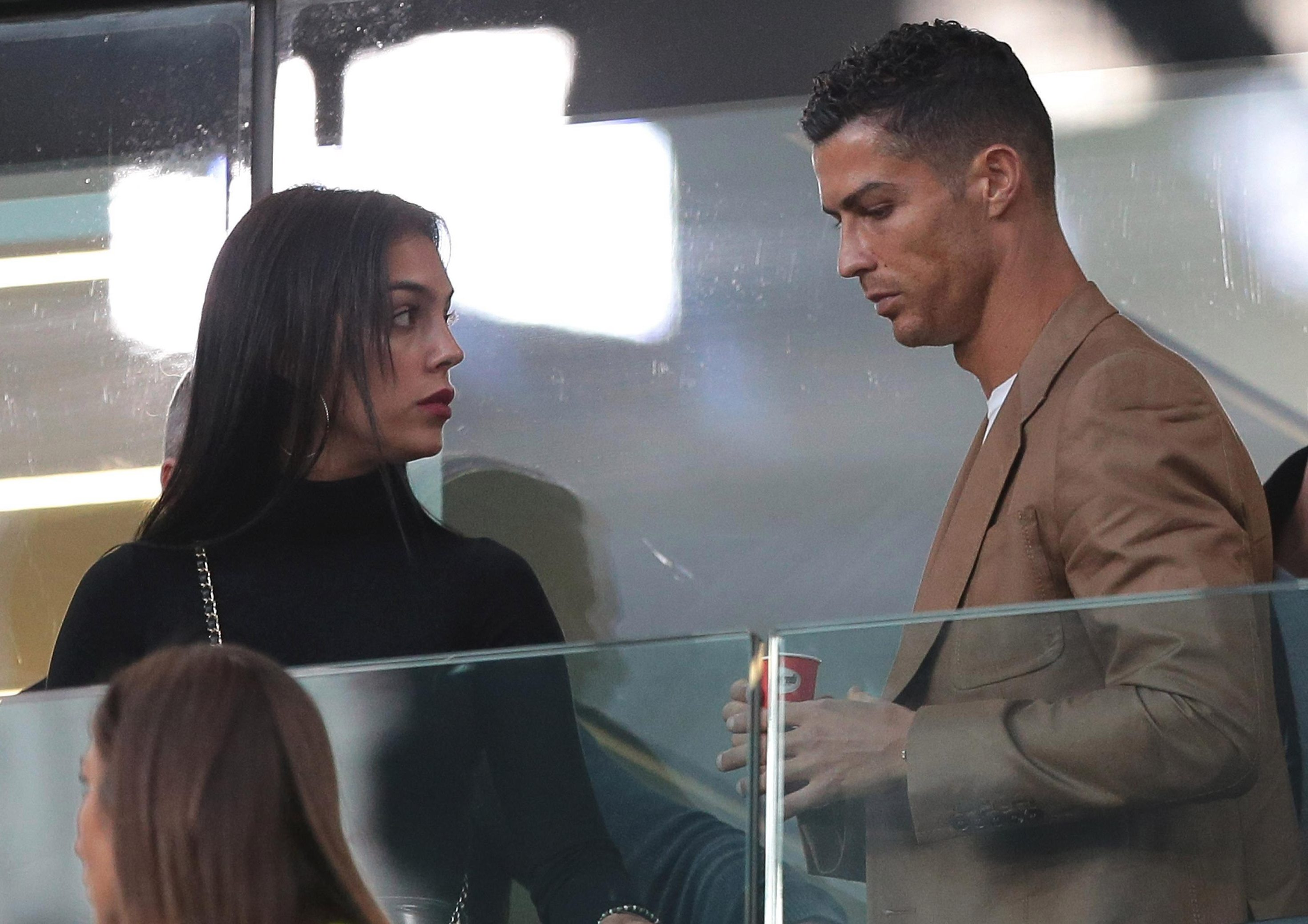 Cristiano Ronaldo and Georgina Rodriguez are seen during the Group H match of the UEFA Champions League