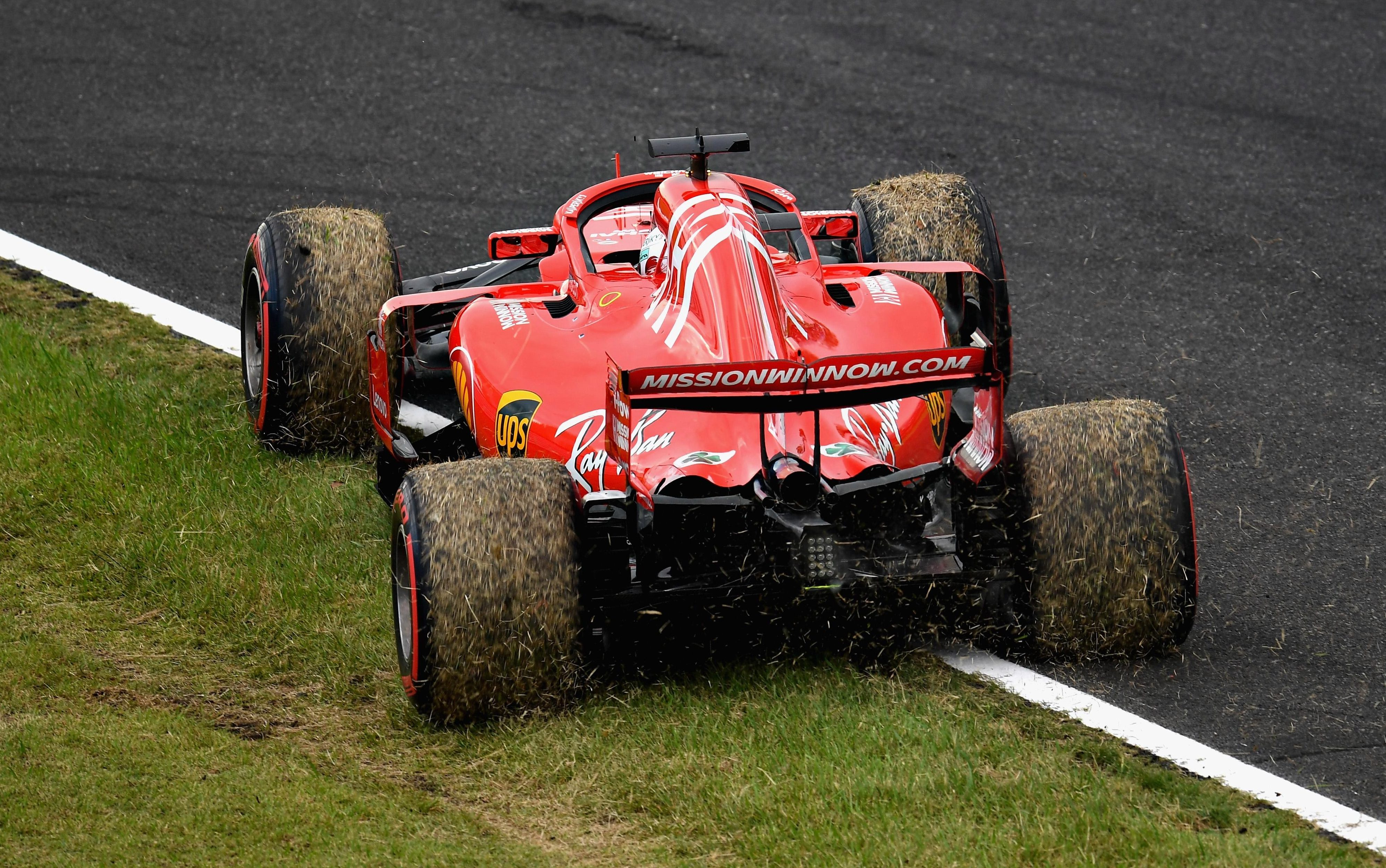 Sebastian Vettel spun on to the grass at Turn 11 but recovered to continue