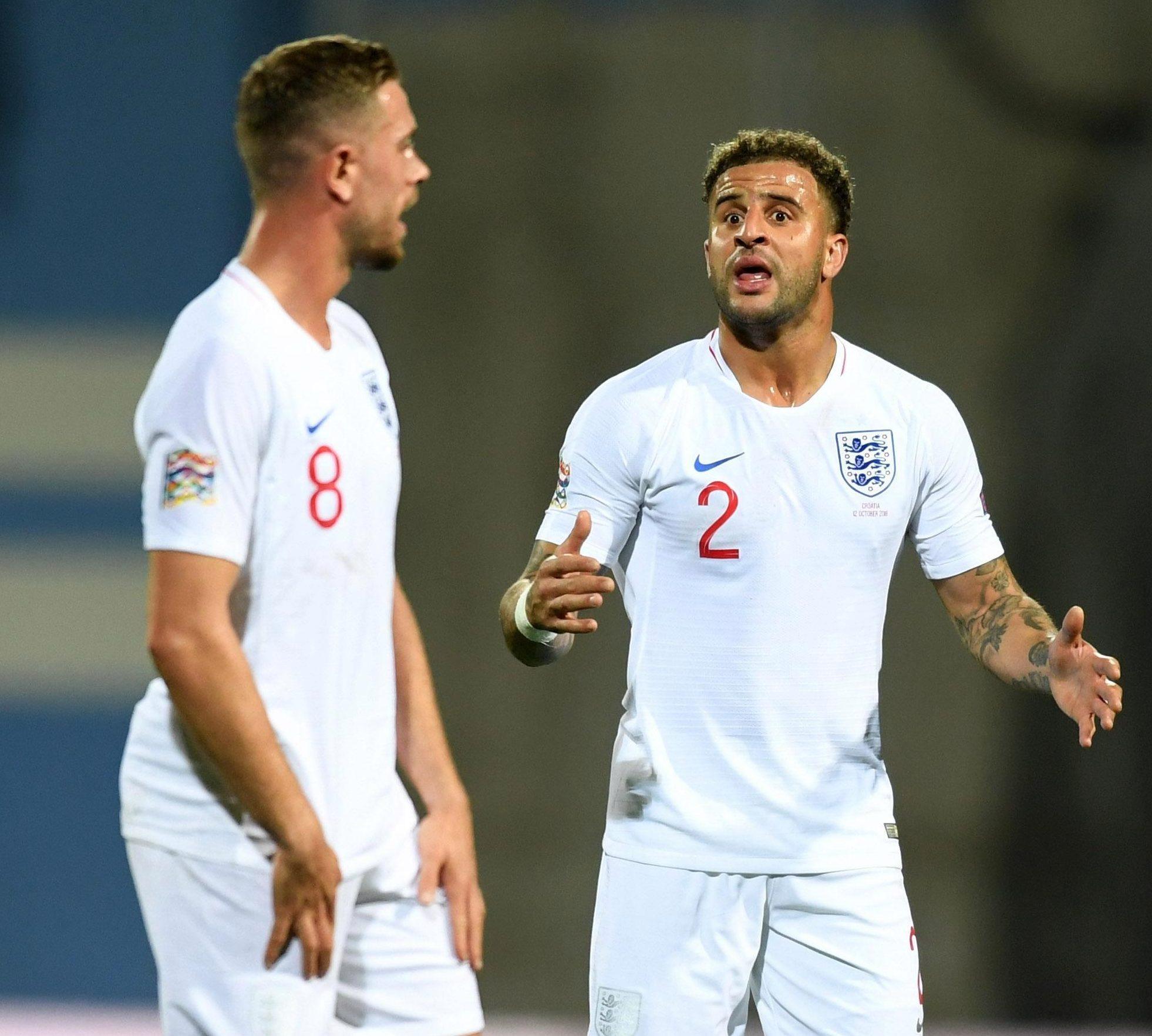 England's Jordan Henderson (left) with Kyle Walker was seen addressing the referee politely