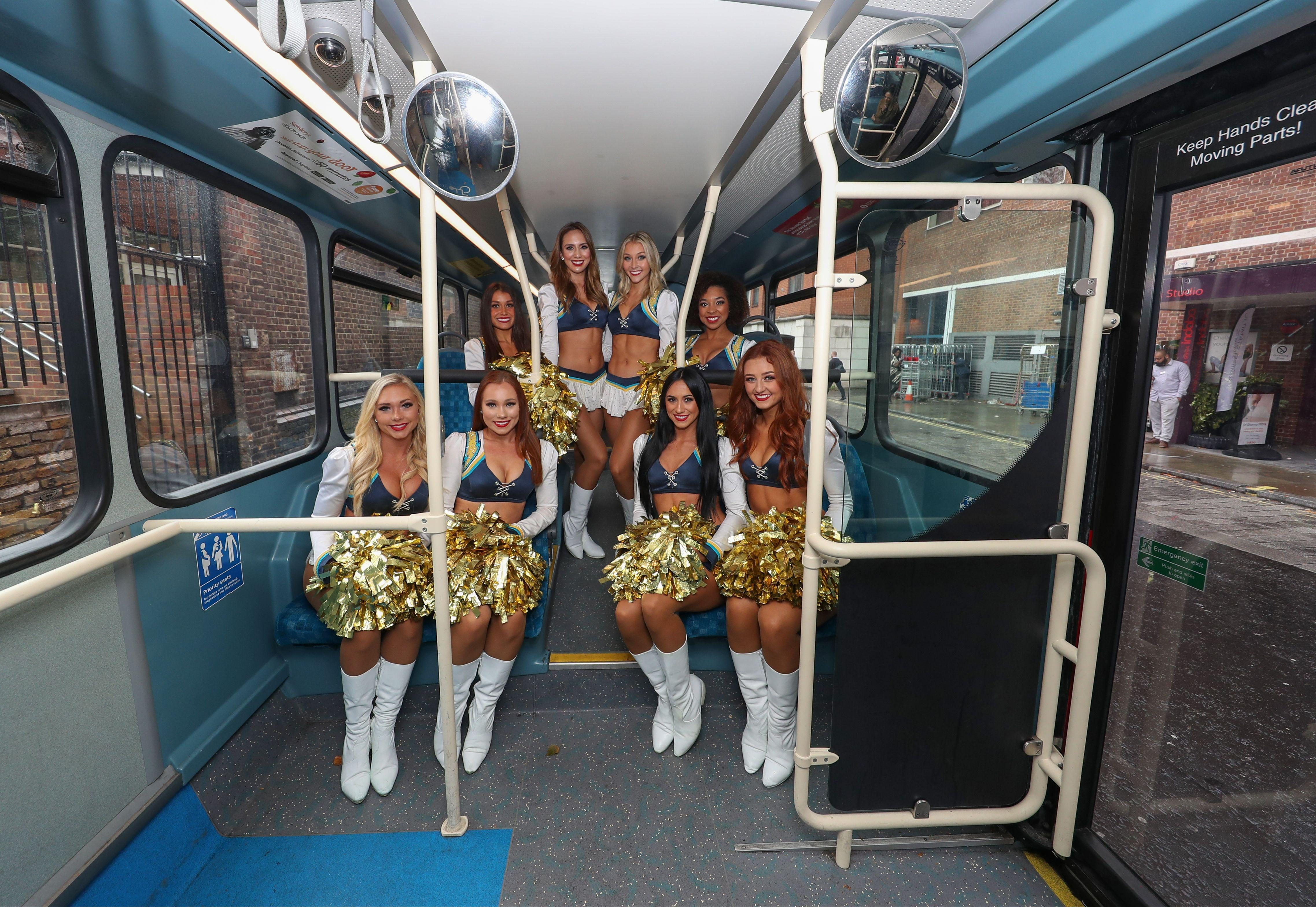The Chargers cheerleaders took a trip on a big red bus during today's trip