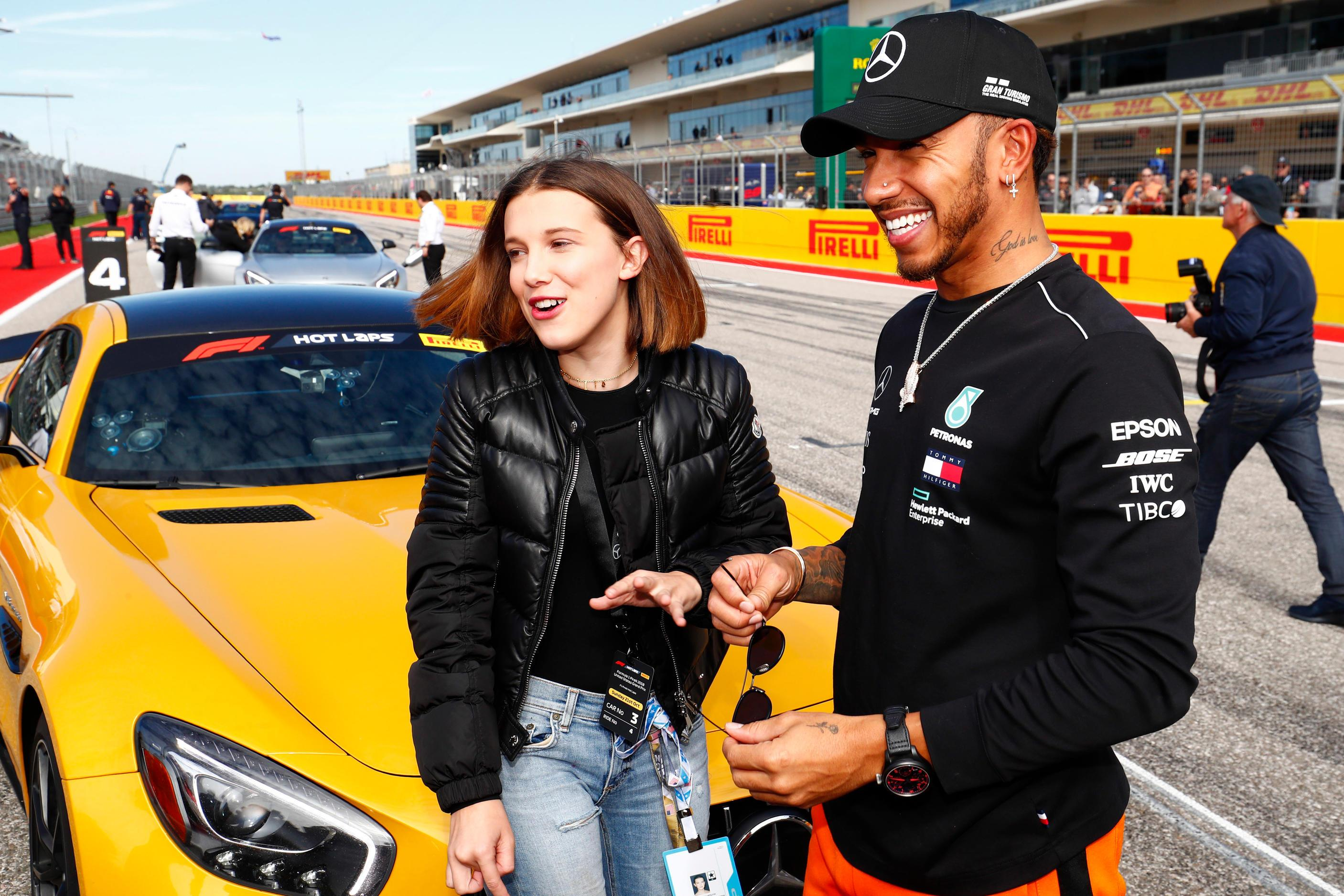 Hamilton jokes with Stranger Things actor Millie Bobby Brown at the USA Grand Prix