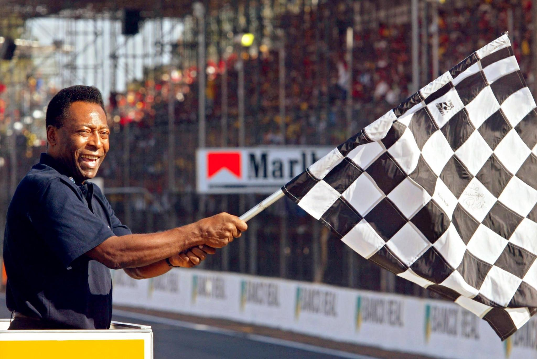 Brazil football icon Pele was left red faced after his flag mishap during the 2002 Grand Prix held in his homeland