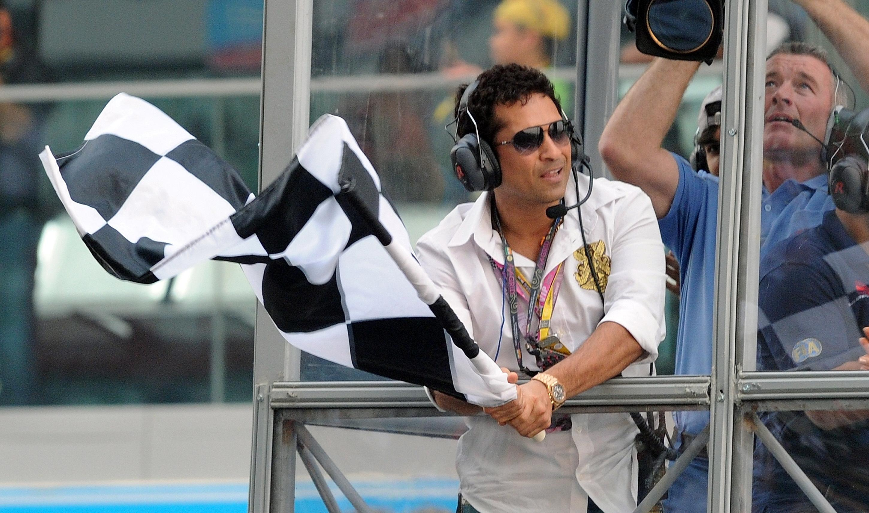 Cricket legend Sachin Tendulkar waved the chequered flag at the end of the inaugural Indian Grand Prix in 2011