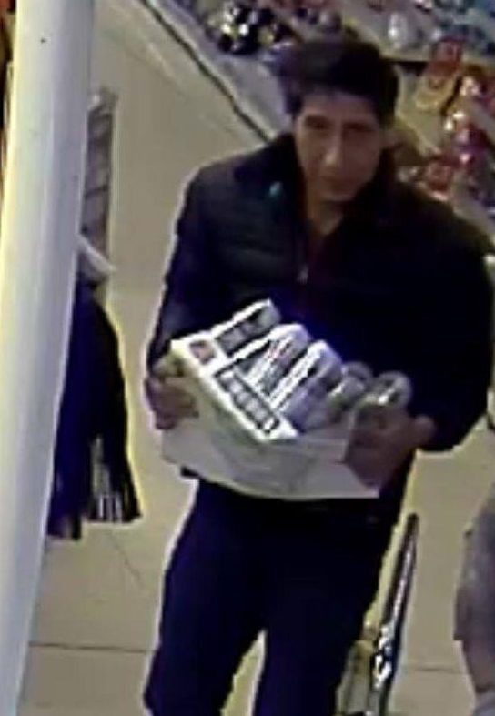 The David Schwimmer lookalike was allegedly seen clutching the beers as he stared down a security camera in Blackpool