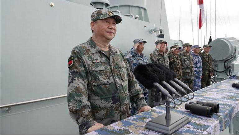 Xi Jinping reviewing a naval parade in the South China Sea, which the country claims as its own in the face of international condemnation