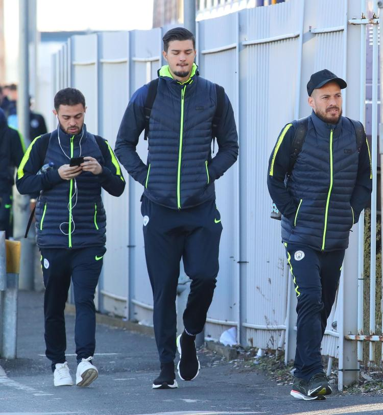 David Silva and Bernardo Silva both looked to be feeling the cold