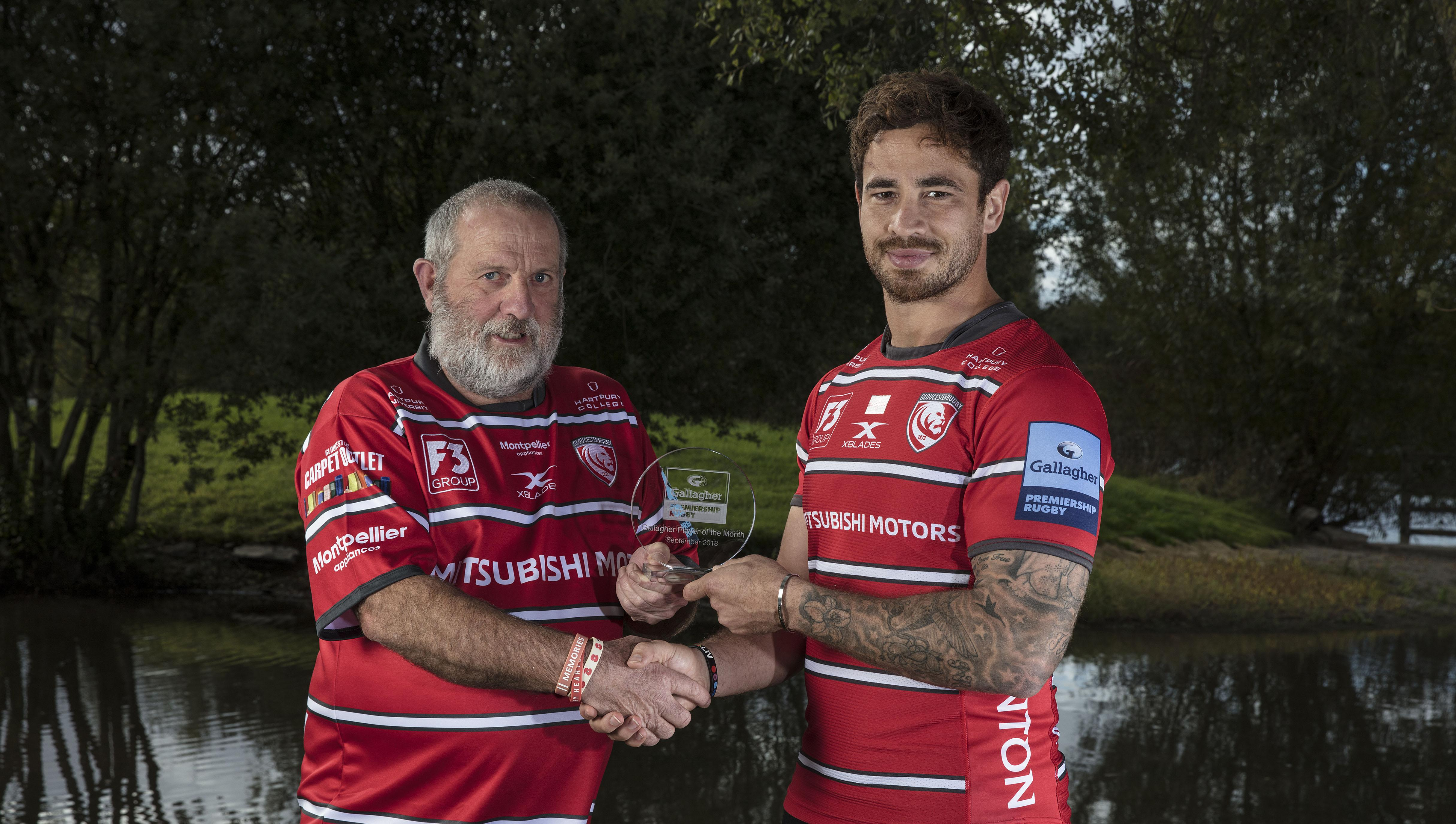 Danny Cipriani collects his award from Gloucester fan Dave Balmer