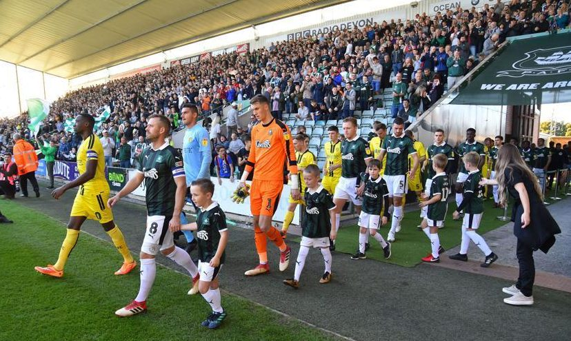 Plymouth and Burton players walk out ahead of a match showing the reality of life outside the Premier League elite