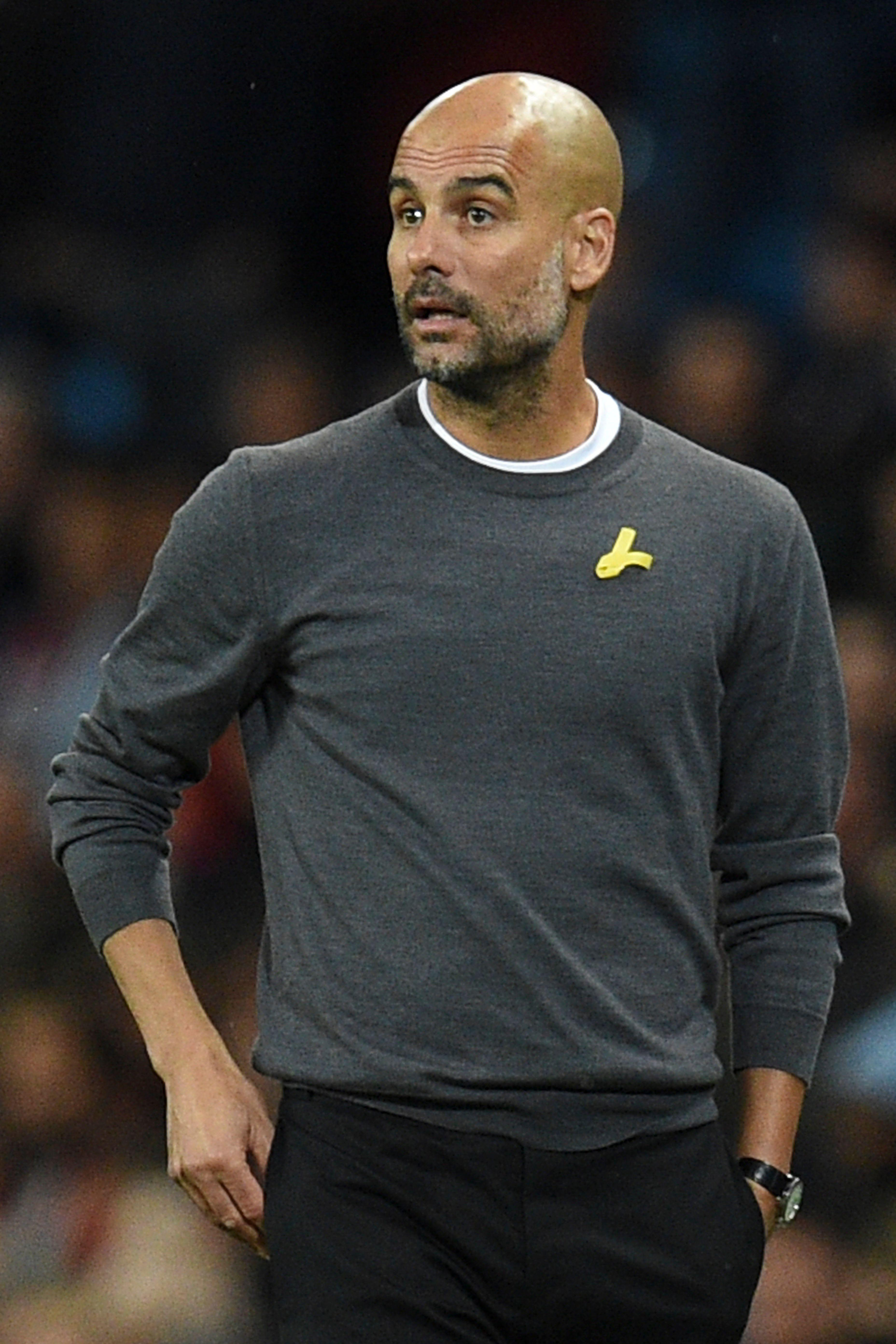 Pep Guardiola will now wear the yellow ribbon up until kick off, then hide it or take it off to avoid being fined
