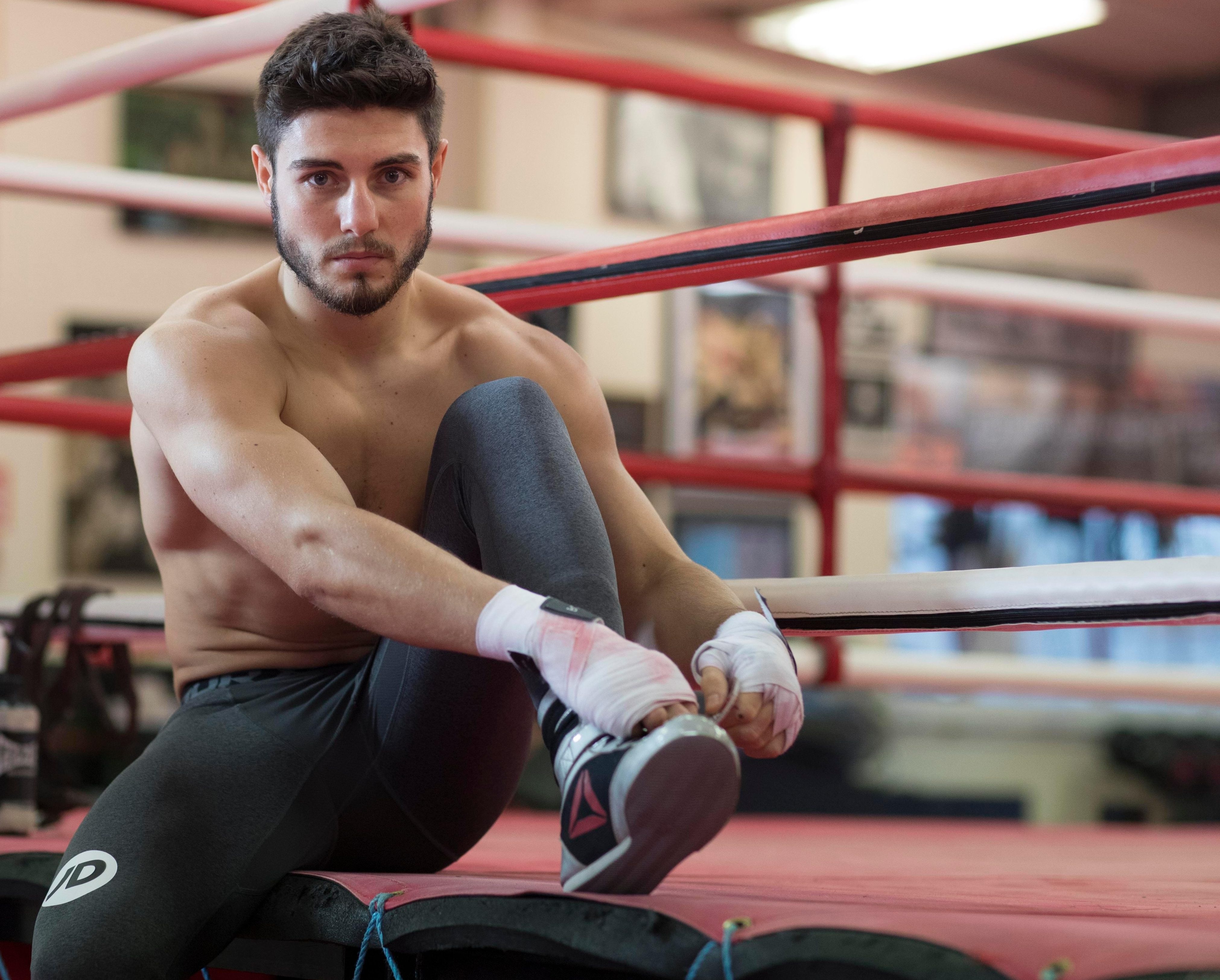 Adam Booth trains Josh Kelly at his Redhill training base