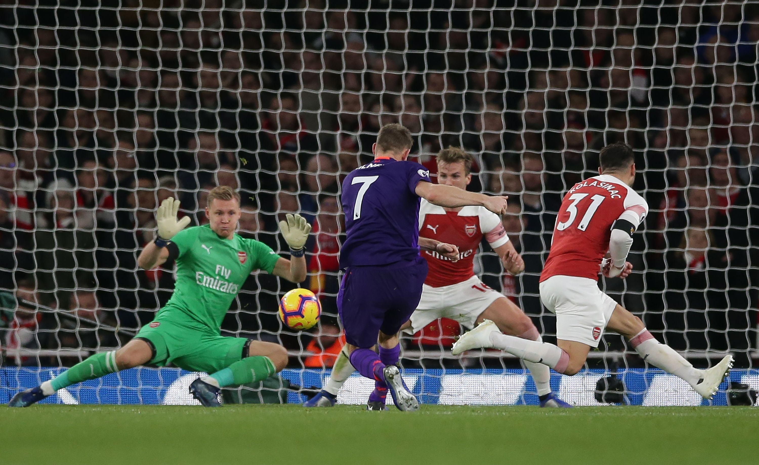 James Milner drives his low shot past Bernd Leno to fire Liverpool into the lead