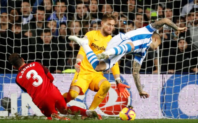 Sandro Ramirez goes flying after catching his toes in the turf as he prepares to shoot, watched by Sevilla defender Sergi Gomez and keeper Vaclik