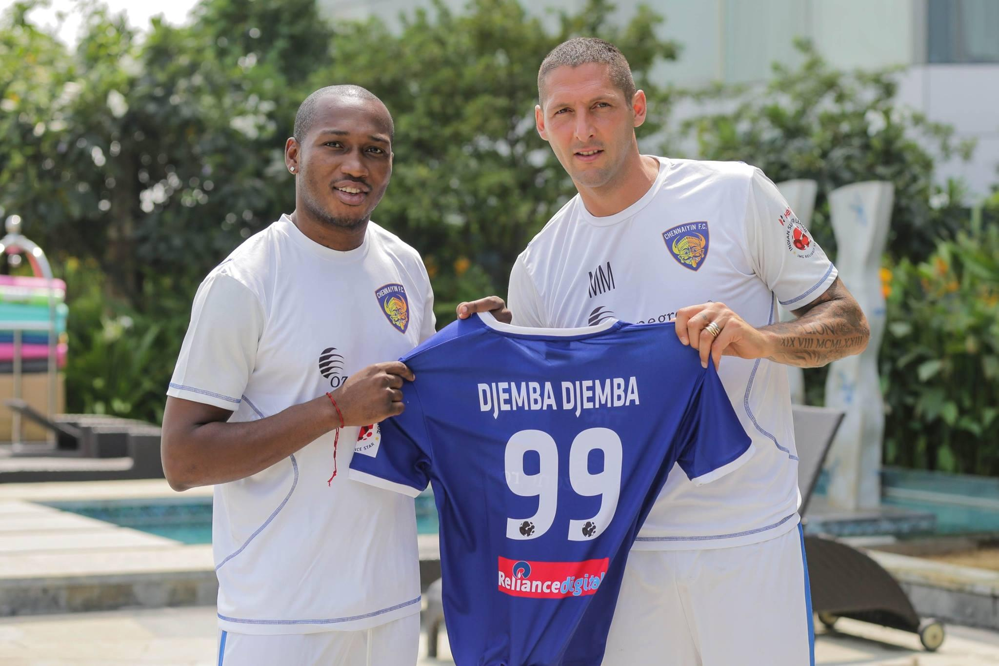 Eric Djemba Djemba stands with Marco Matterazi - with his name correct