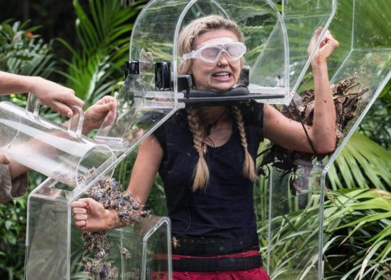 Georgia Toffolo doing the John Trevolt-ing bushtucker trial
