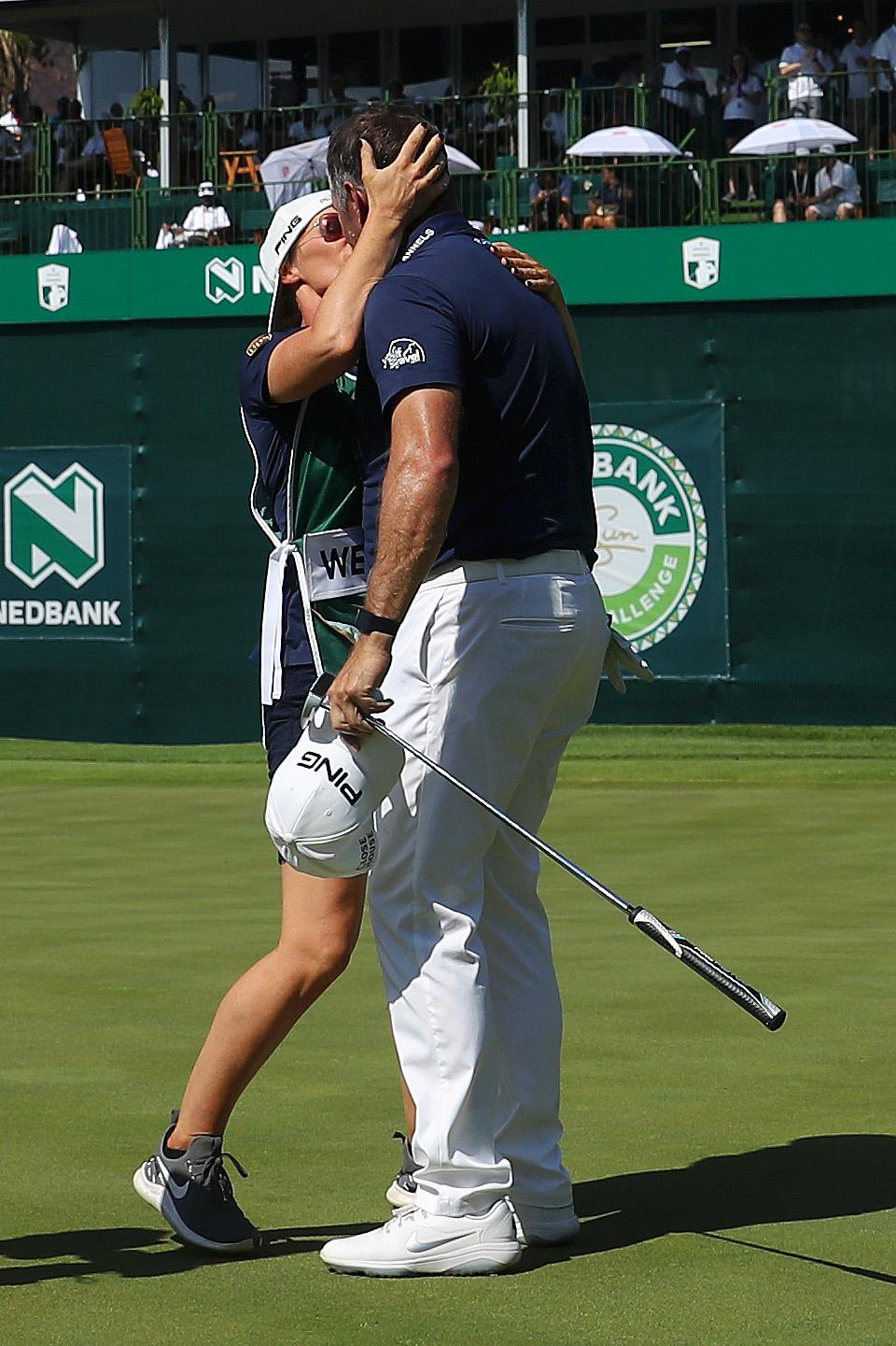 Lee Westwood planted a kiss on his caddie after winning the Nedbank Challenge