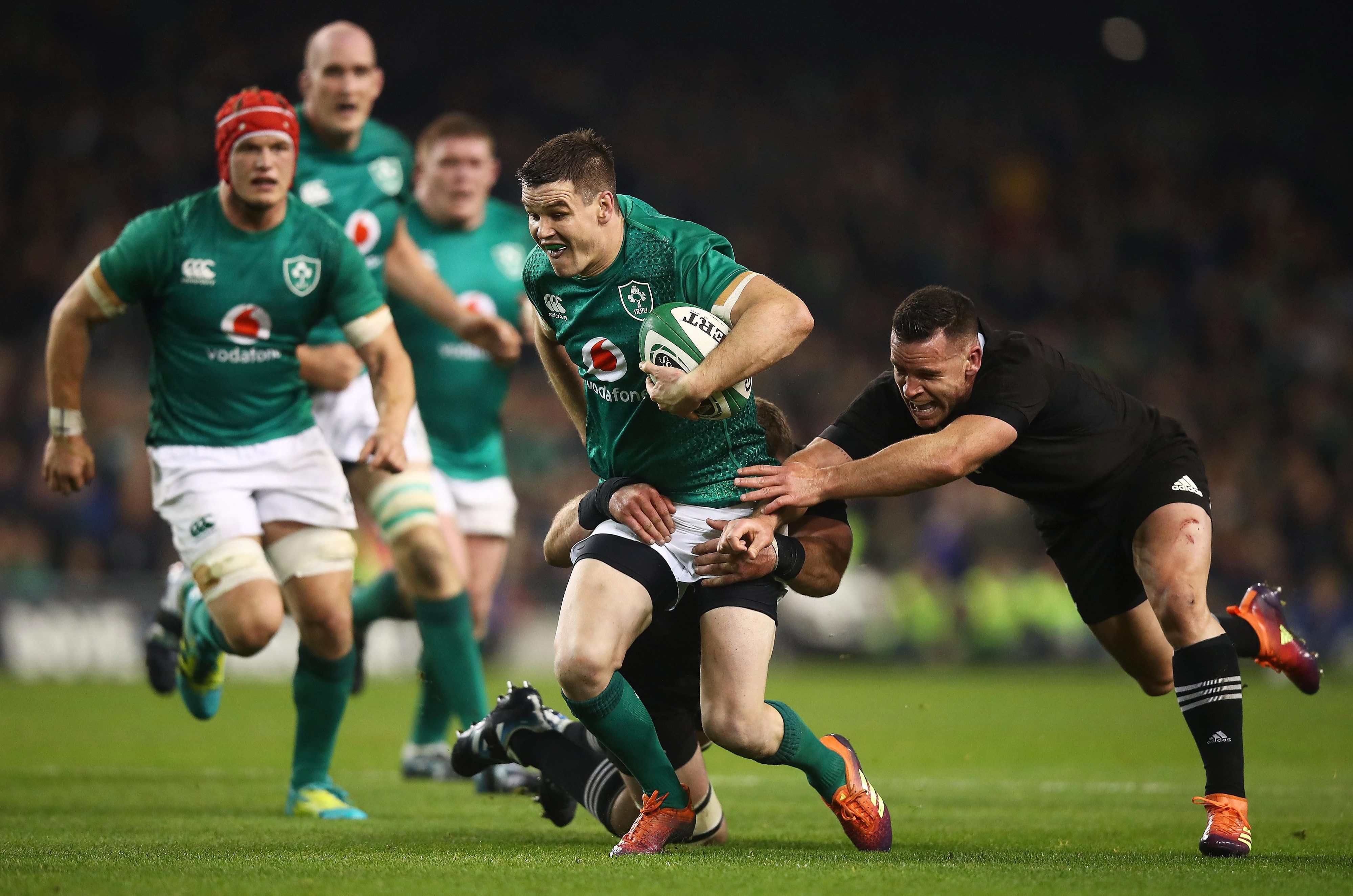 Johnny Sexton, who bagged a penalty and three conversions, powers past All Blacks ace Ryan Crotty