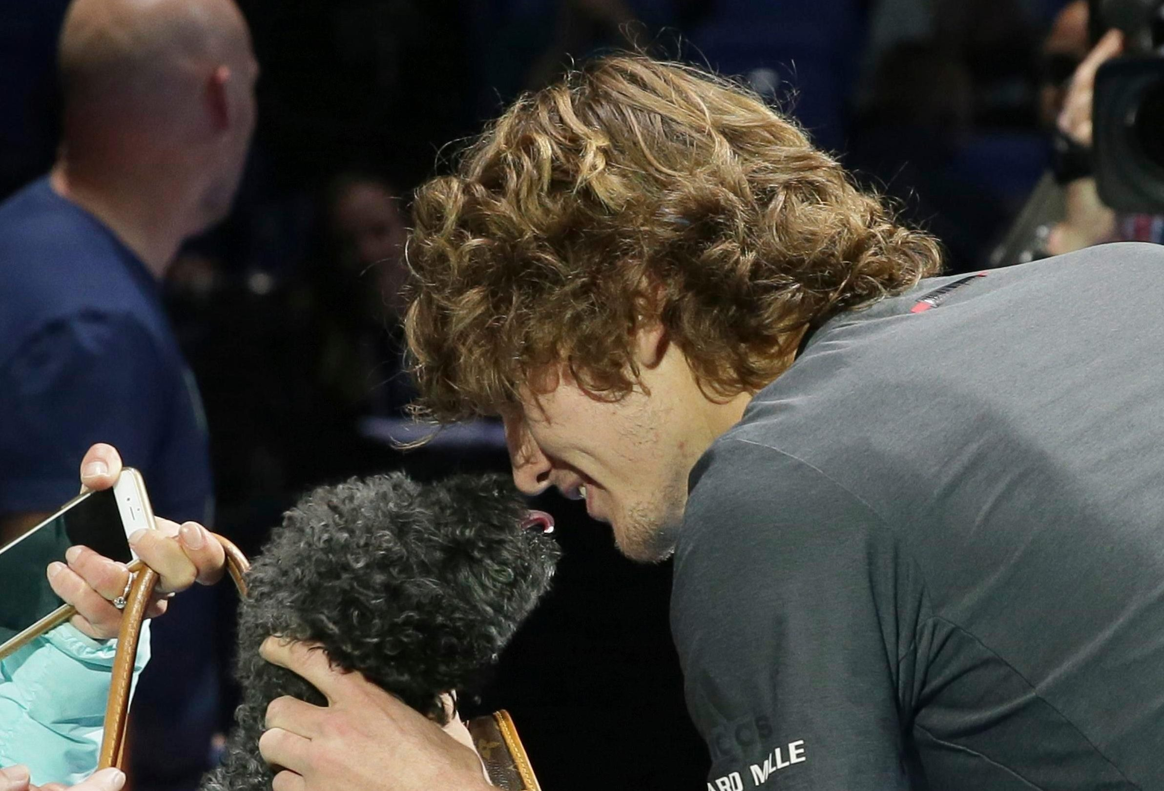 Alex Zverev kisses the family puppy after beating Novak Djokovic to clinch the ATP Finals crown - having shown he should be able to winalot more in the future