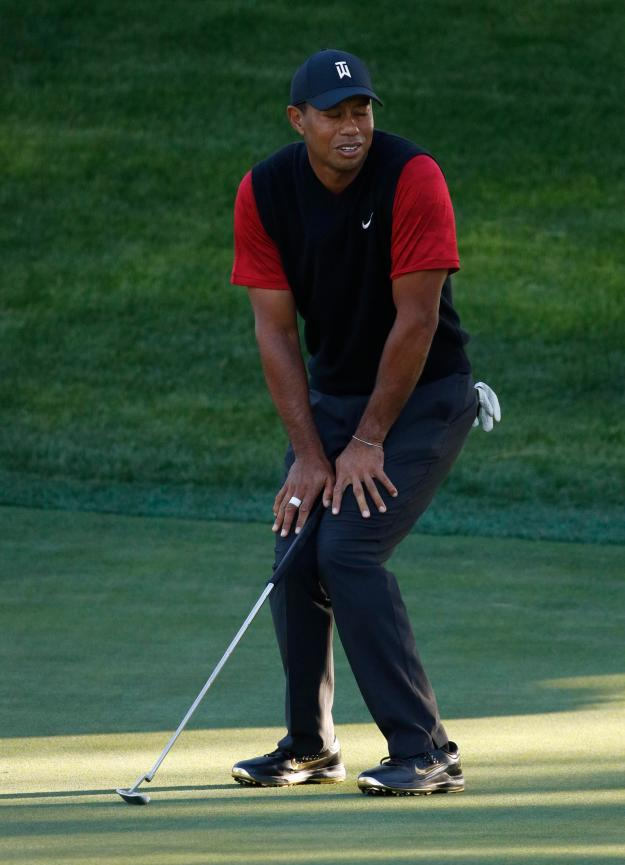 Tiger Woods watches a putt go sailing past the hole in the play-off