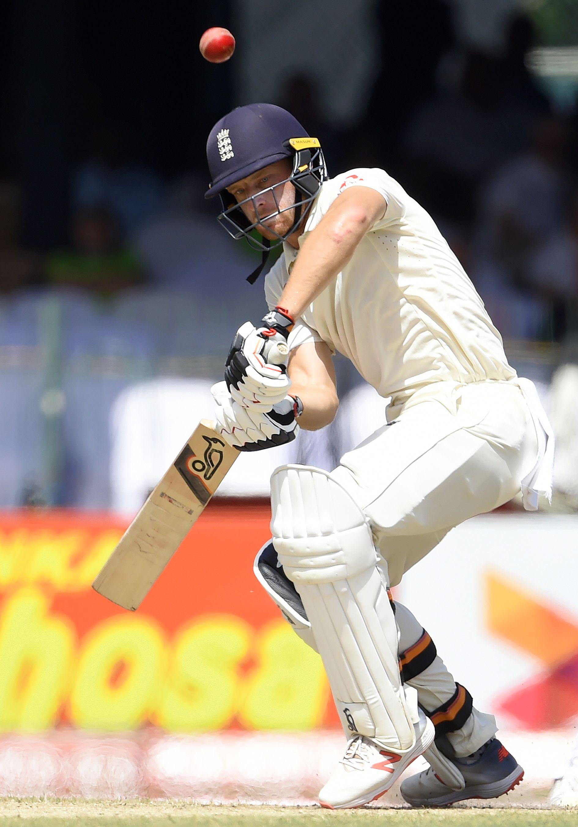 Jos Buttler hit a superb 50 to seize the initiative in Colombo