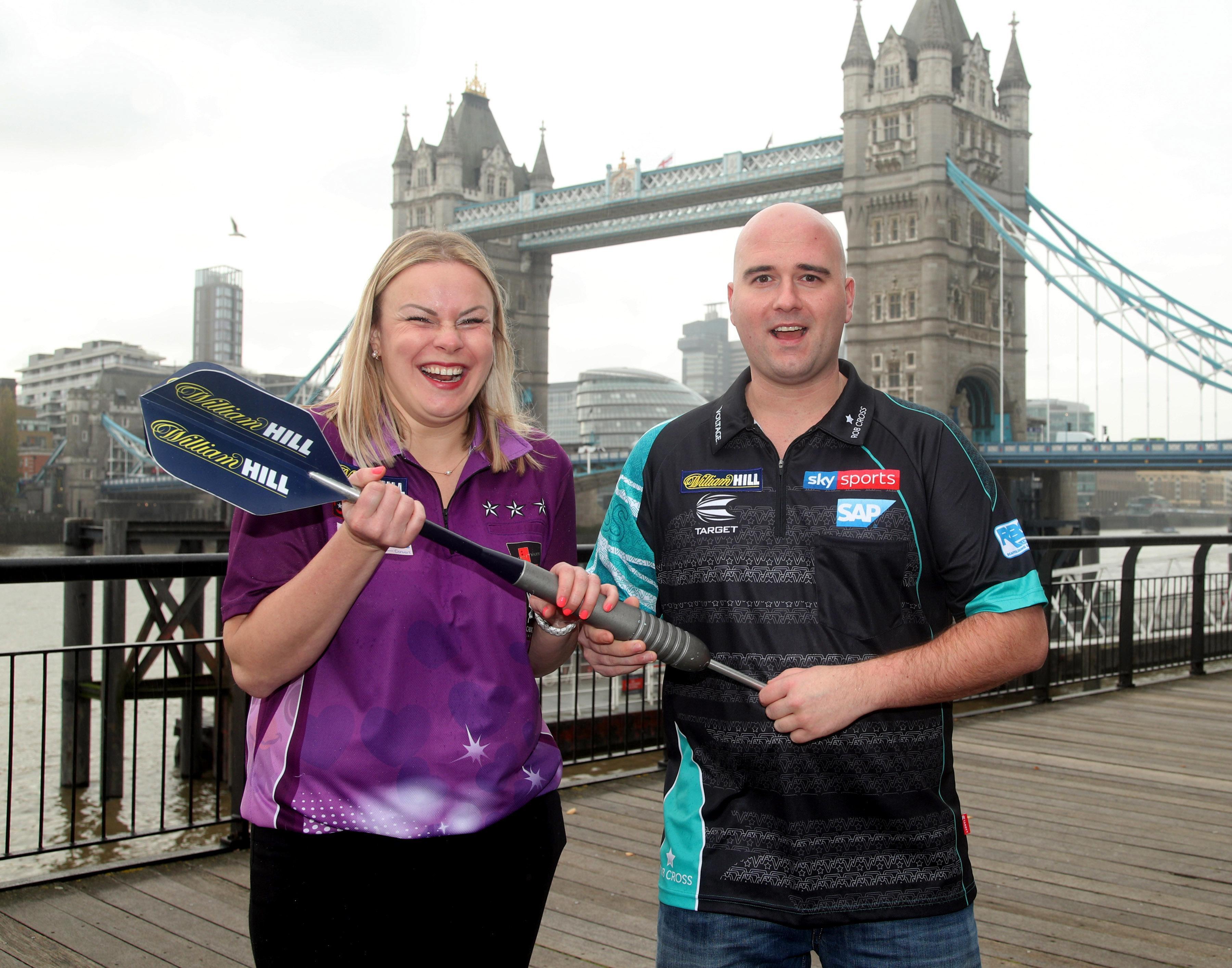 Anastasia Dobromyslova poses with world champion Rob Cross