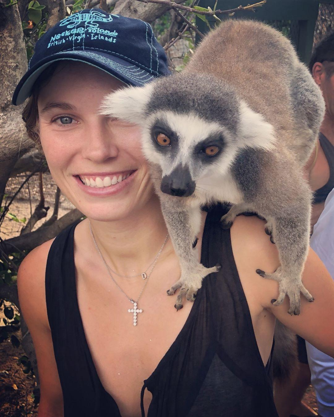 Caroline Wozniacki poses with a monkey while relaxing in the Caribbean
