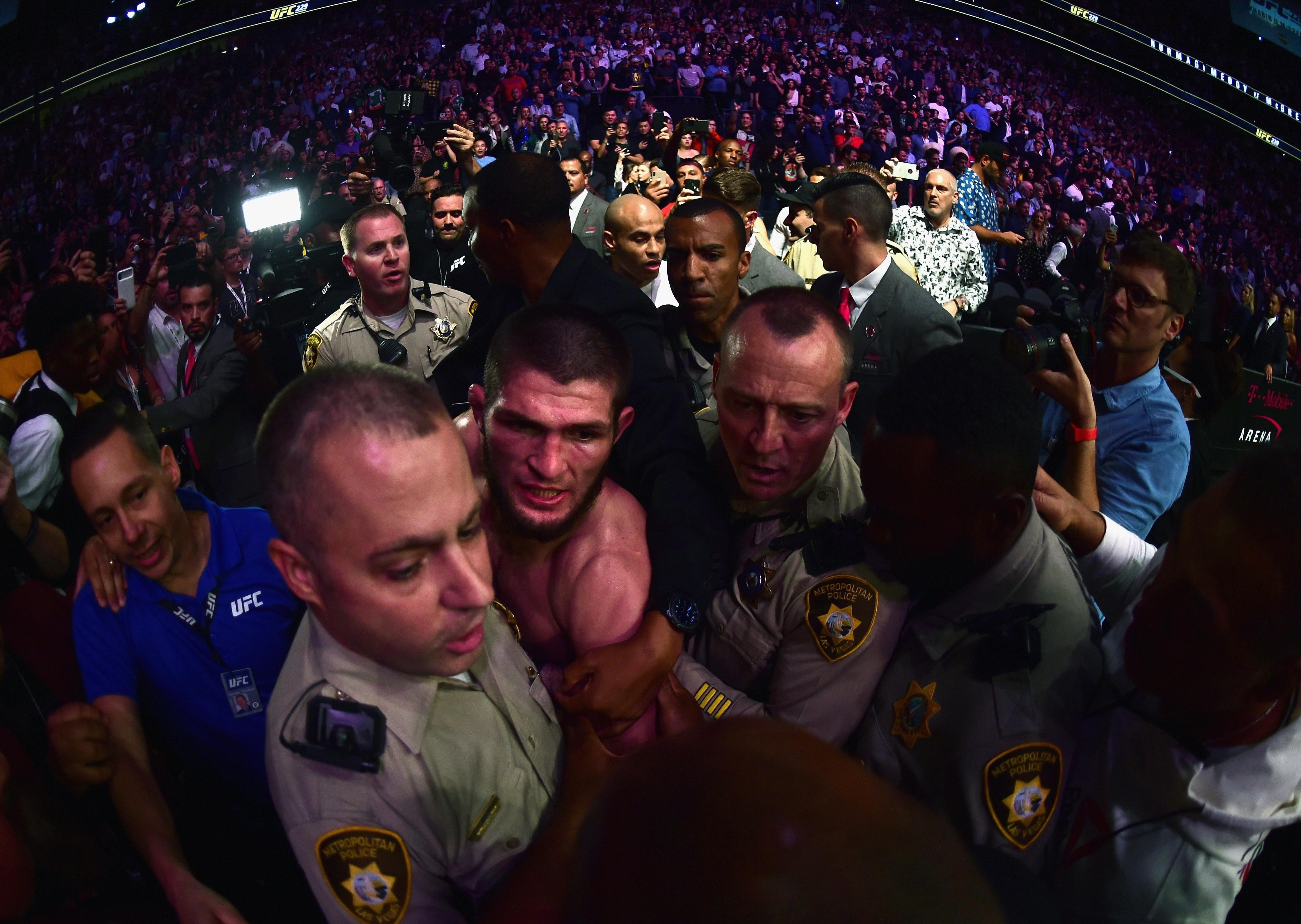 The mayhem exploded into life when Khabib Nurmagomedov scaled cage after the fight to confront Dillon Danis