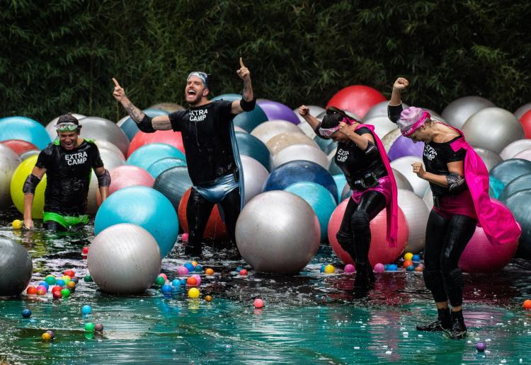The team celebrate after being battered by dozens of giant plastic balls