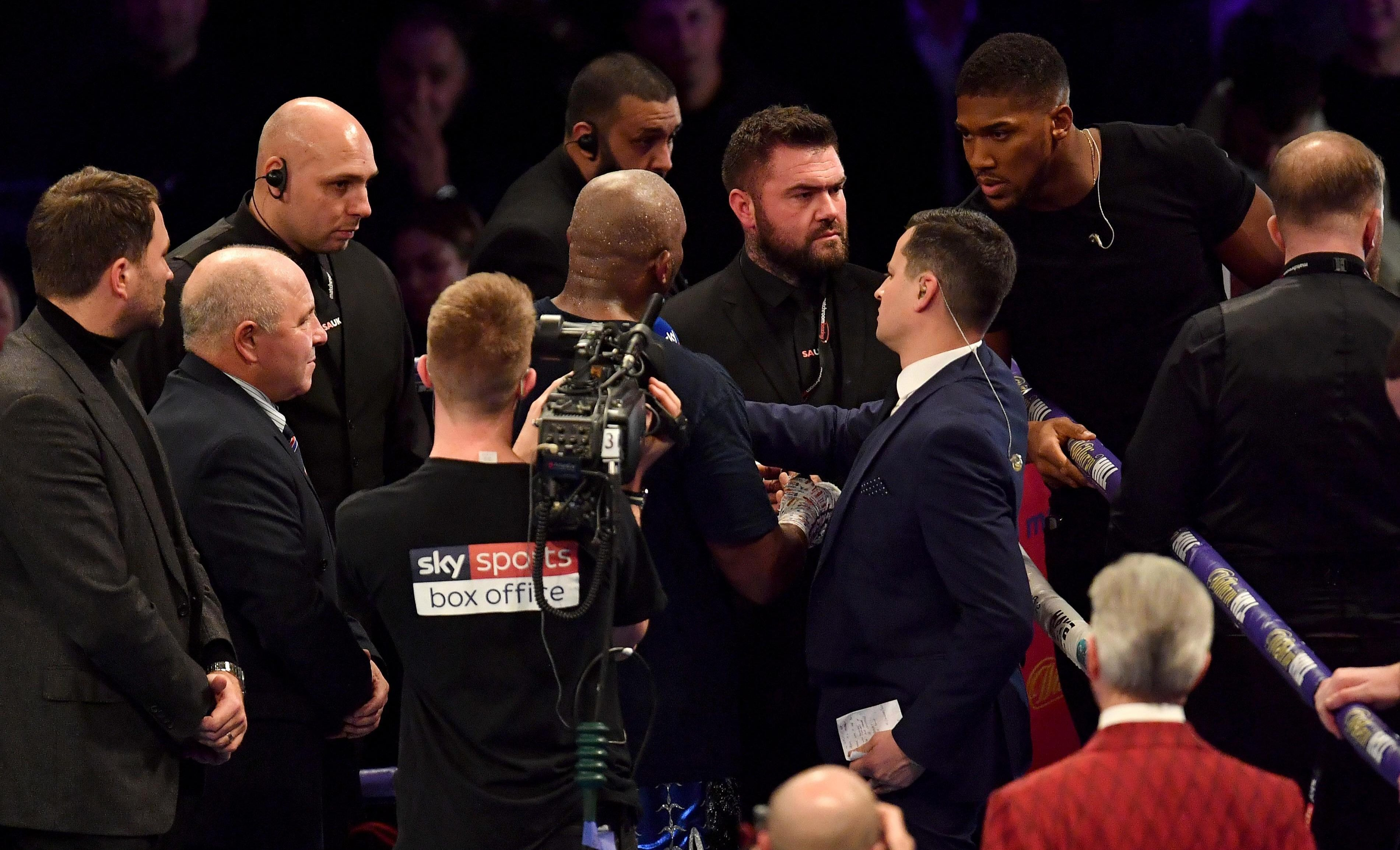 Anthony Joshua climbed in the ring after Dillian Whyte's last fight but was booed out