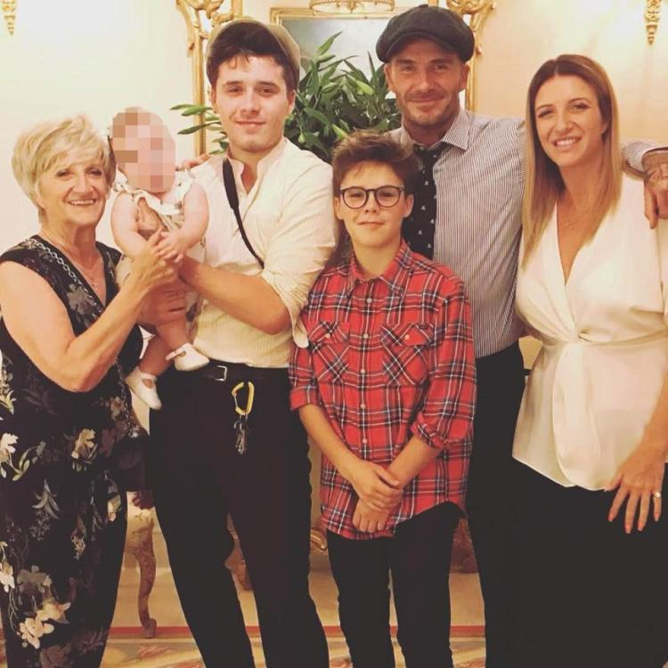 Peggy, pictured here with members of the Beckham family, was born last December
