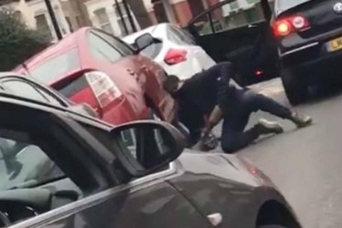 Moment thieves shamelessly hold up traffic to steal £400 catalytic converter off parked car as thieves target them for scrap metal