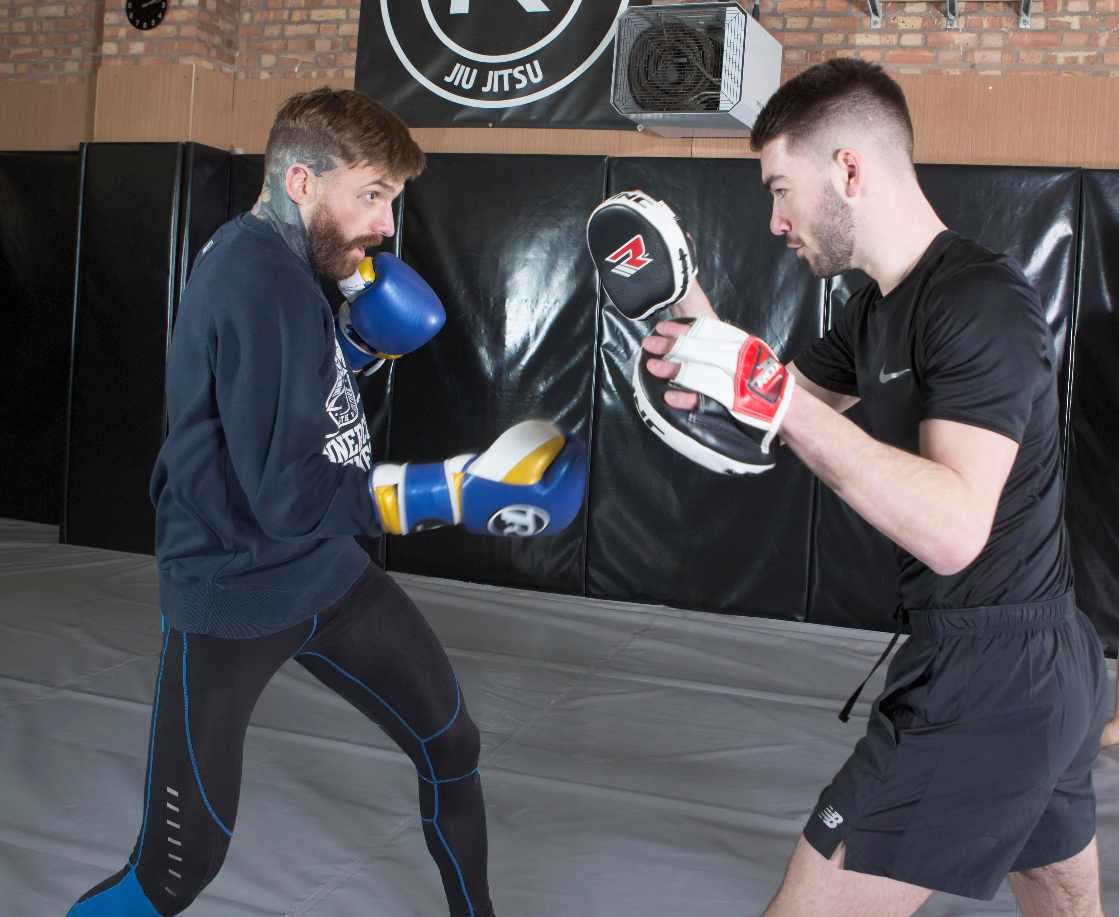 SunSport reporter Jack Figg holds the pads for Aaron Chalmers at his Birmingham gym