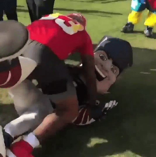 Pat Patriot was tackled to the ground by Jamal Adams