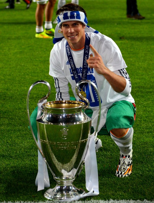 Gareth Bale says hes thrilled to be winning trophies at Real Madrid