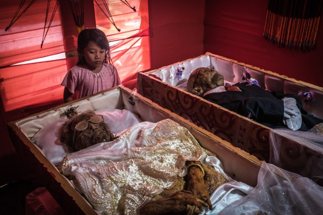 The dead relatives of the Toraja people are kept at home or in special 'ancestral' homes until their funeral