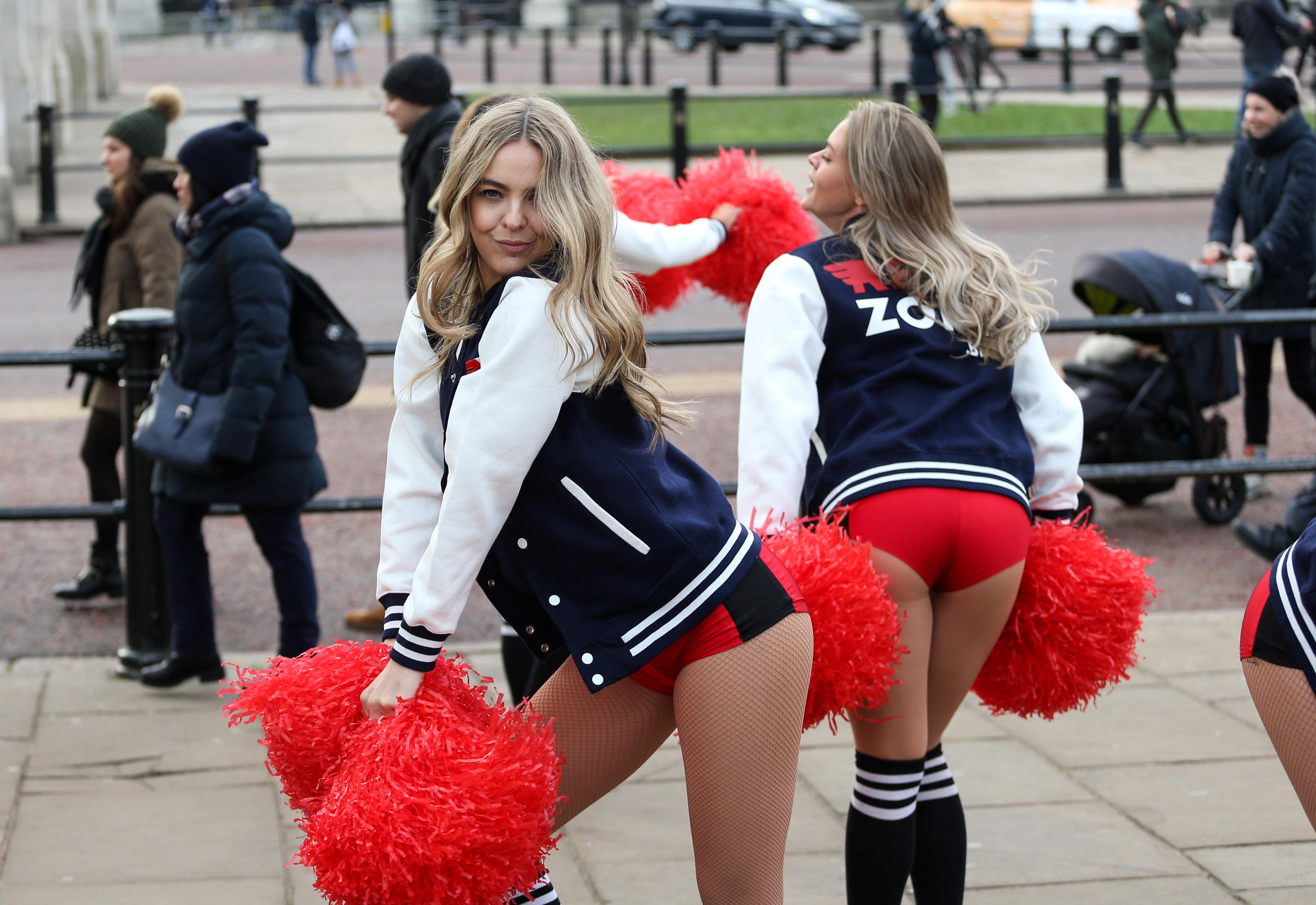 Cheerleaders whip Brits up into a frenzy in London