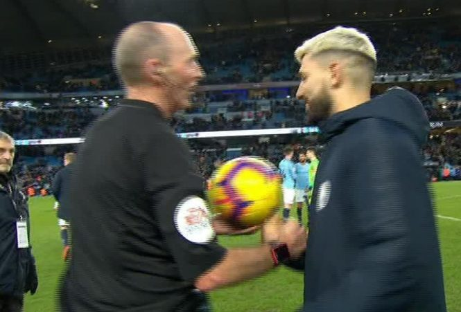 Mike Dean finally offers up the ball and shakes hands with Sergio Aguero