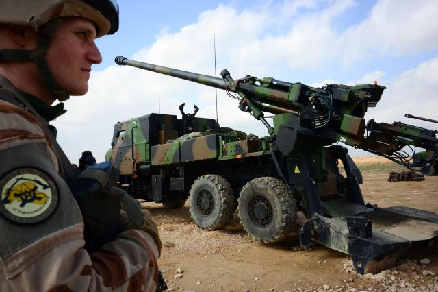 """A French soldier engaged in the """"Operation Chammal"""", the French military operation a few kilometres away from the last scrap of territory held by IS in eastern Syria"""